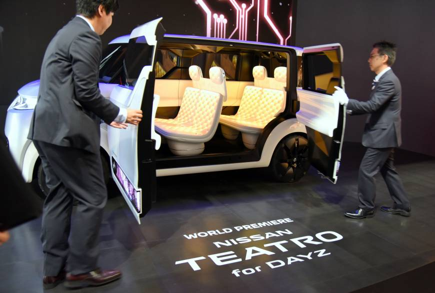 Staff open the doors of the Nissan Teatro for Dayz at the 44th Tokyo Motor Show 2015, which continues until Nov. 8.