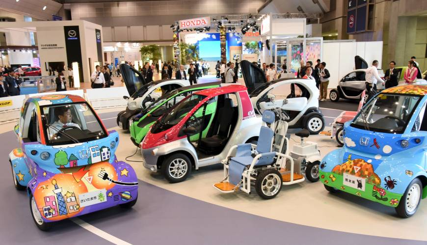 A visitor takes a spin in one-person vehicle in a corner of the Tokyo Motor Show showcases the
