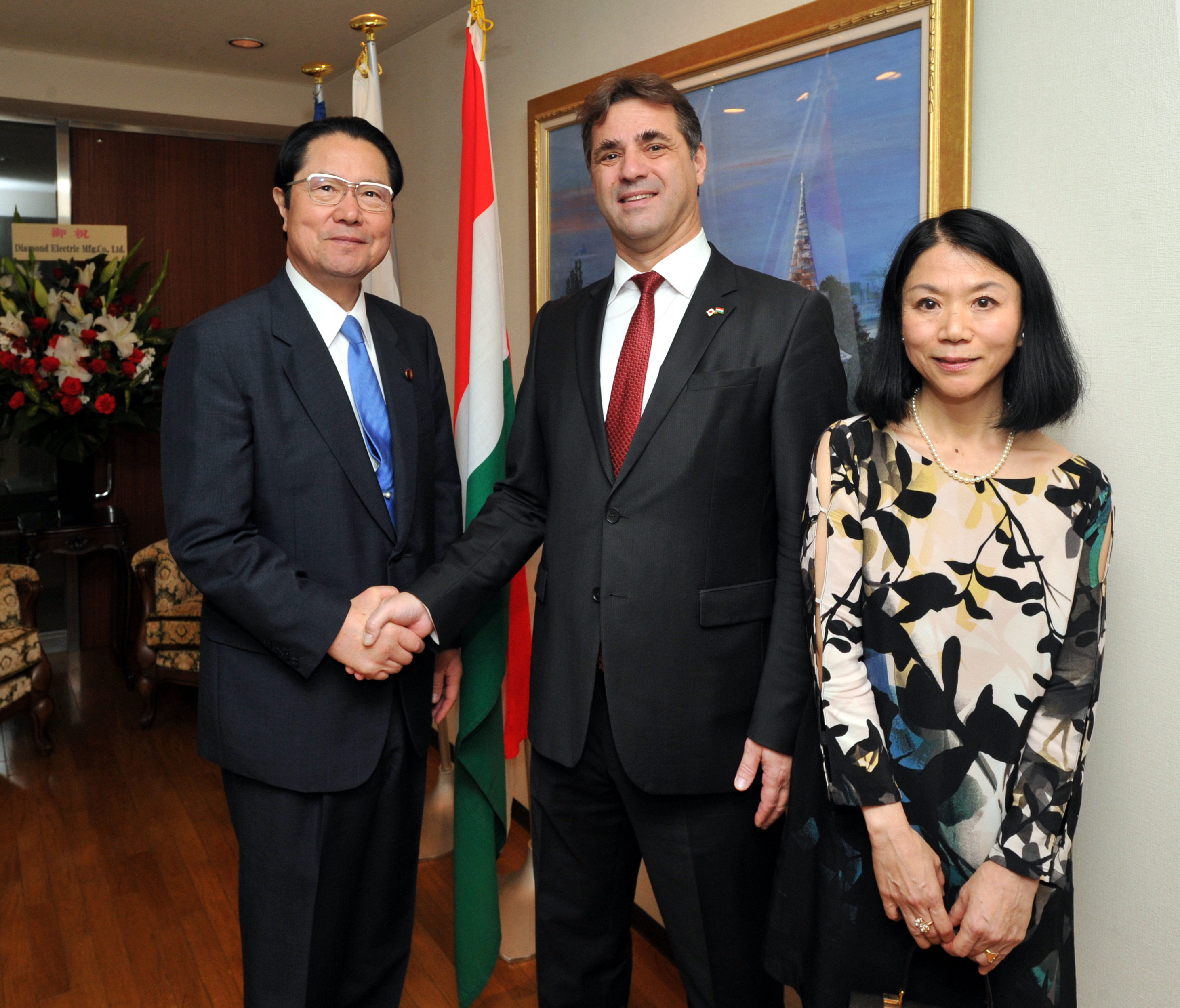 Hungarian Ambassador Istvan Szerdahelyi (center) and his wife, Reiko, welcome Seishiro Eto, chairman of the Japan-Hungary Parliamentary Friendship League, during a reception celebrating the country's National Day at the embassy in Tokyo on Oct. 22. | YOSHIAKI MIURA