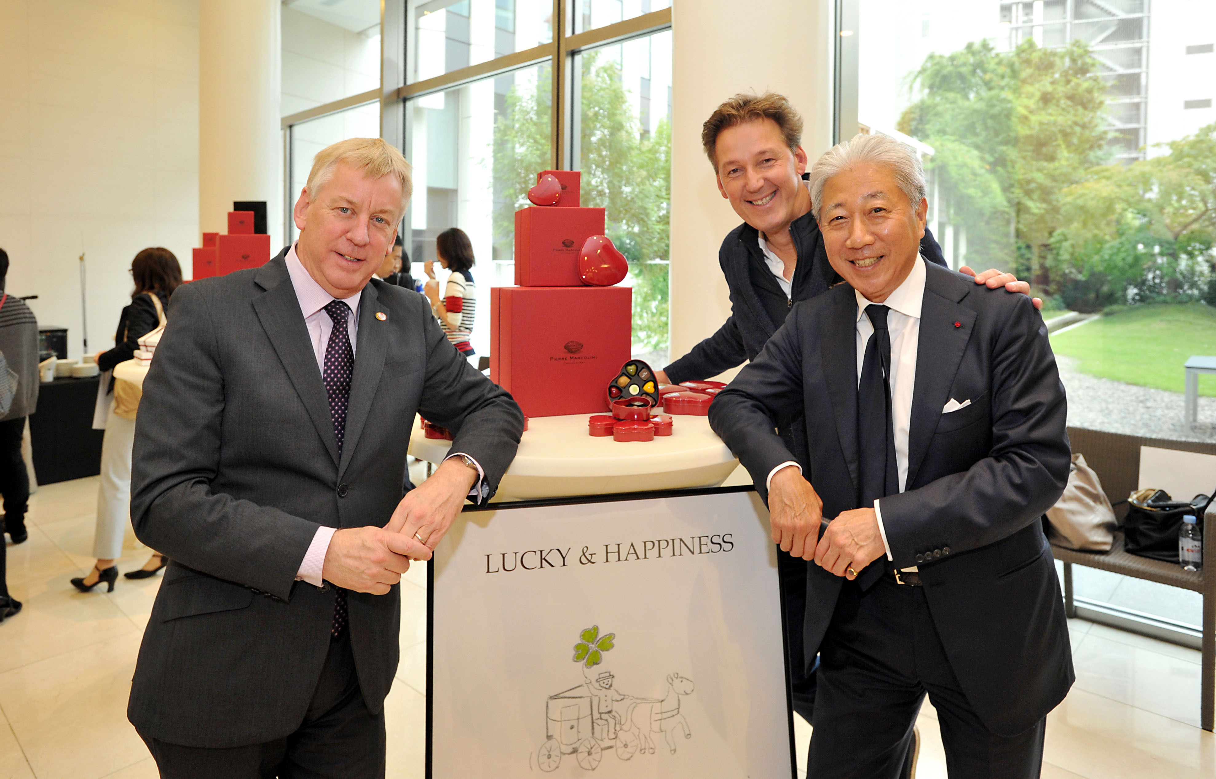 Belgian chocolatier Pierre Marcolini (second from right) poses with Belgian Ambassador Gunther Sleeuwagen (left) and Yushi Tajima, president of The Cream of the Crop and Co., on a visit to Japan to announce new products for next St. Valentine's and White days at the Belgian embassy in Tokyo on Oct. 15.  | YOSHIAKI MIURA
