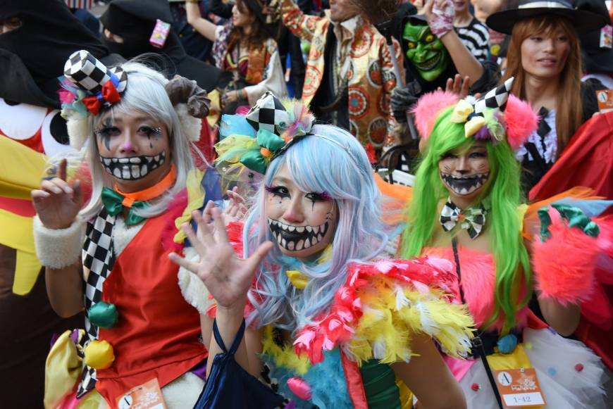 People decked out in a variety of costumes participate in a parade in Kawasaki on Sunday during Kawasaki Halloween 2015. The annual event, now in its 19th year, brought together some 2,500 people and stretched for about 1.5 km.