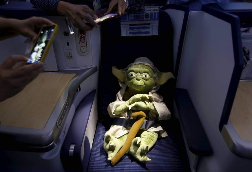 Master Yoda takes a break from fighting the Sith in order to enjoy business class.