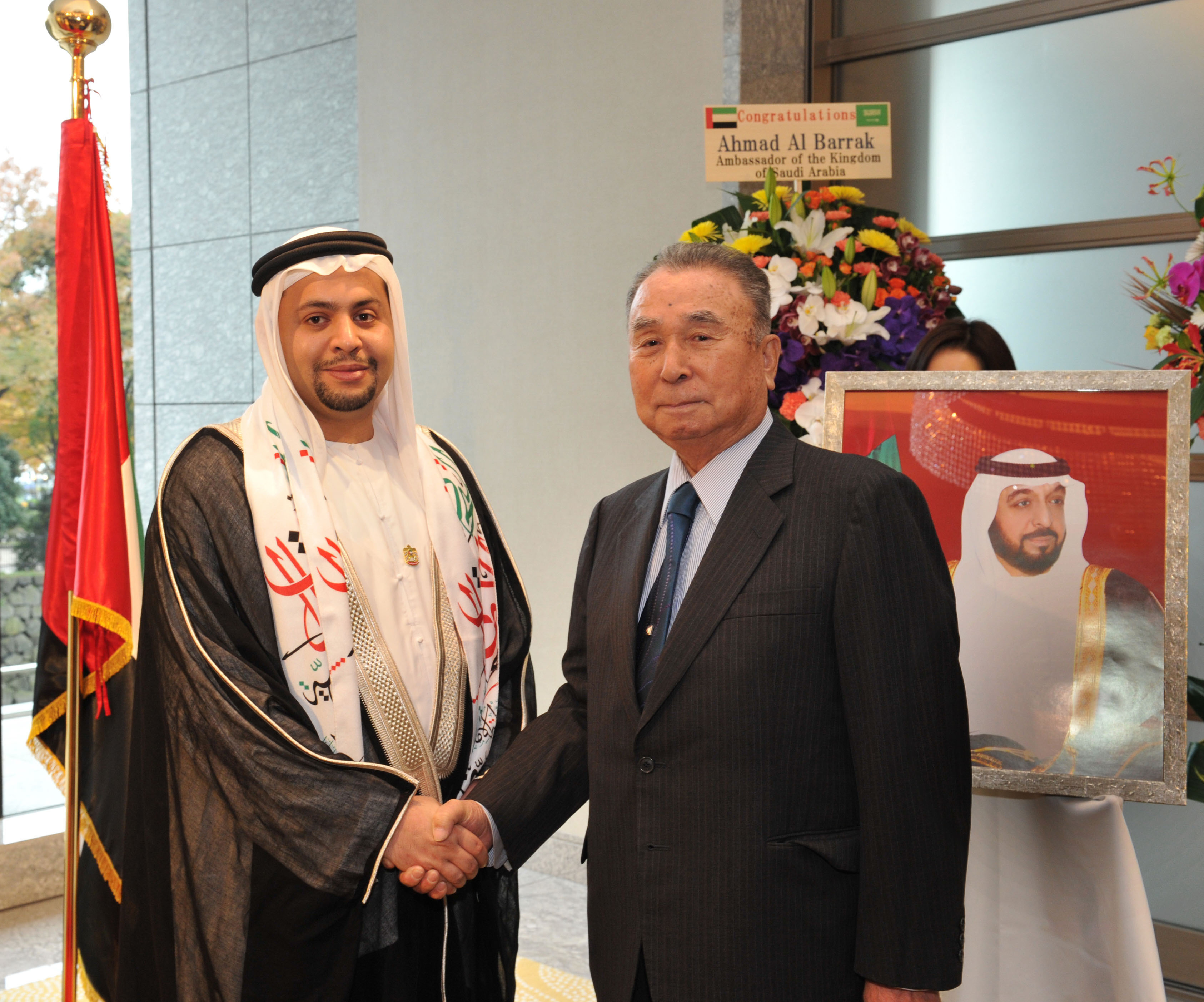 Charge d'Affaires of the United Arab Emirates Mutaz Al Faheem (left) welcomes Keiichiro Okabe, president of the UAE-Japan Society, during a reception celebrating the 44th Anniversary of the country's National Day at the Palace Hotel Tokyo on Dec. 2. | YOSHIAKI MIURA