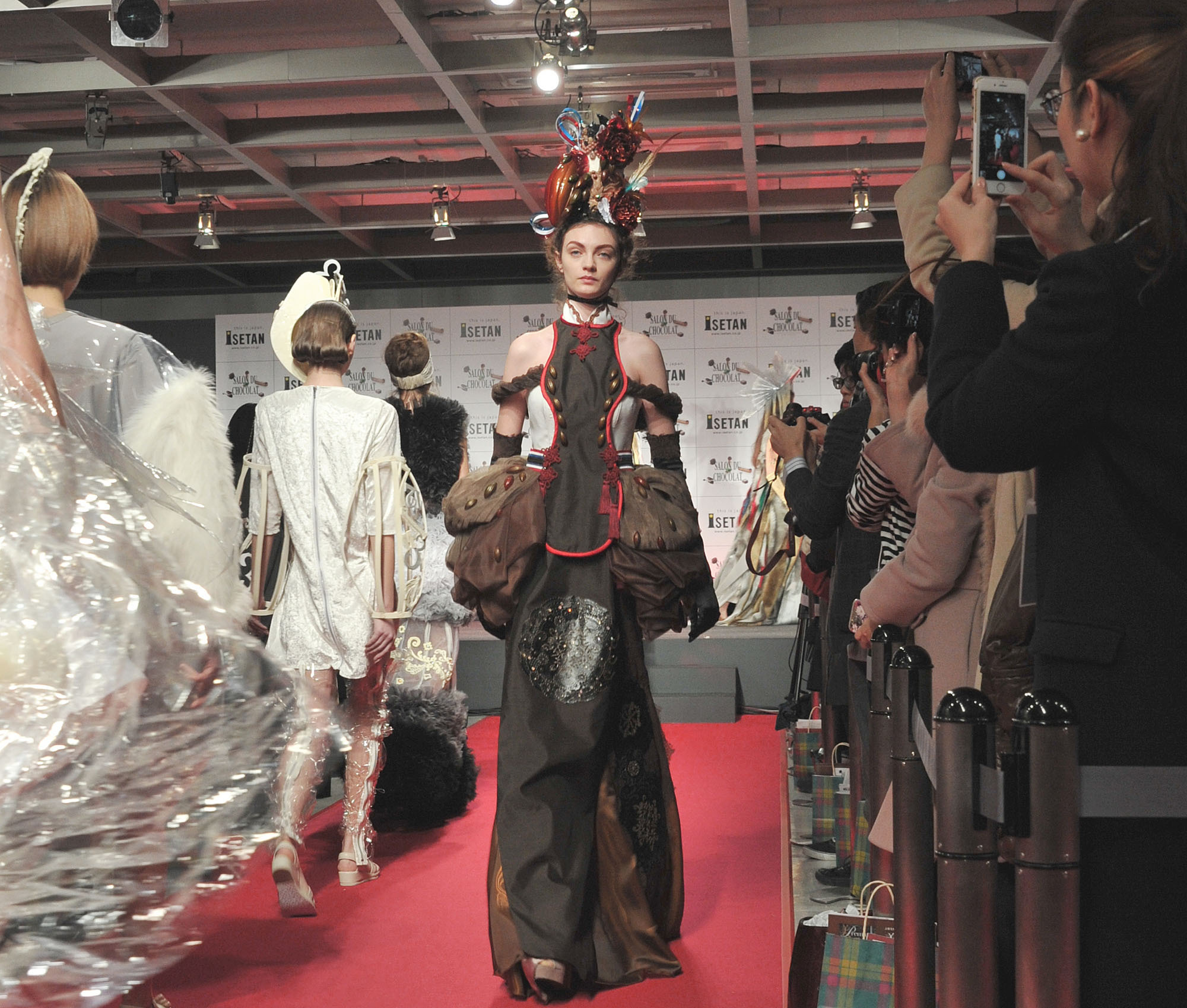 Models walk the runway in a chocolate-inspired fashion show in the Shinjuku NS Building on Jan. 26, the press day for the Salon du Chocolat 2016 Isetan, which boasts creations from about 100 chocolatiers from 19 countries. | YOSHIAKI MIURA