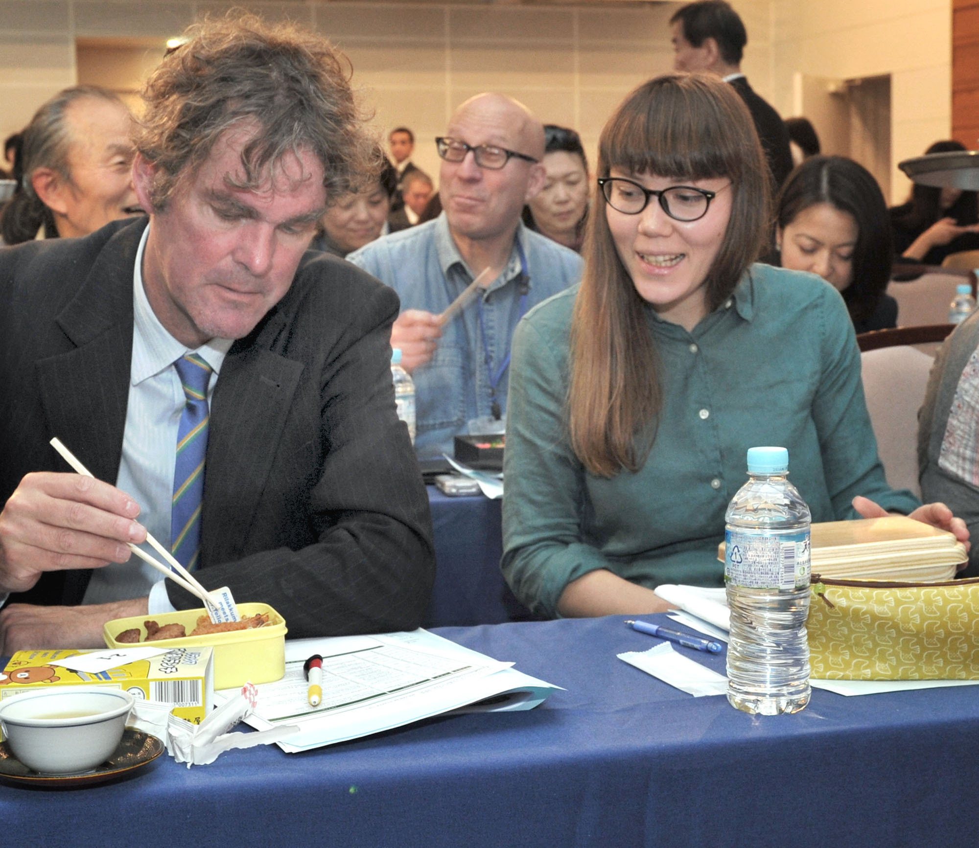 Journalists experience the flavors of 100 ekiben from across Japan at The International House of Japan, in Tokyo on Jan. 14. |  YOSHIAKI MIURA