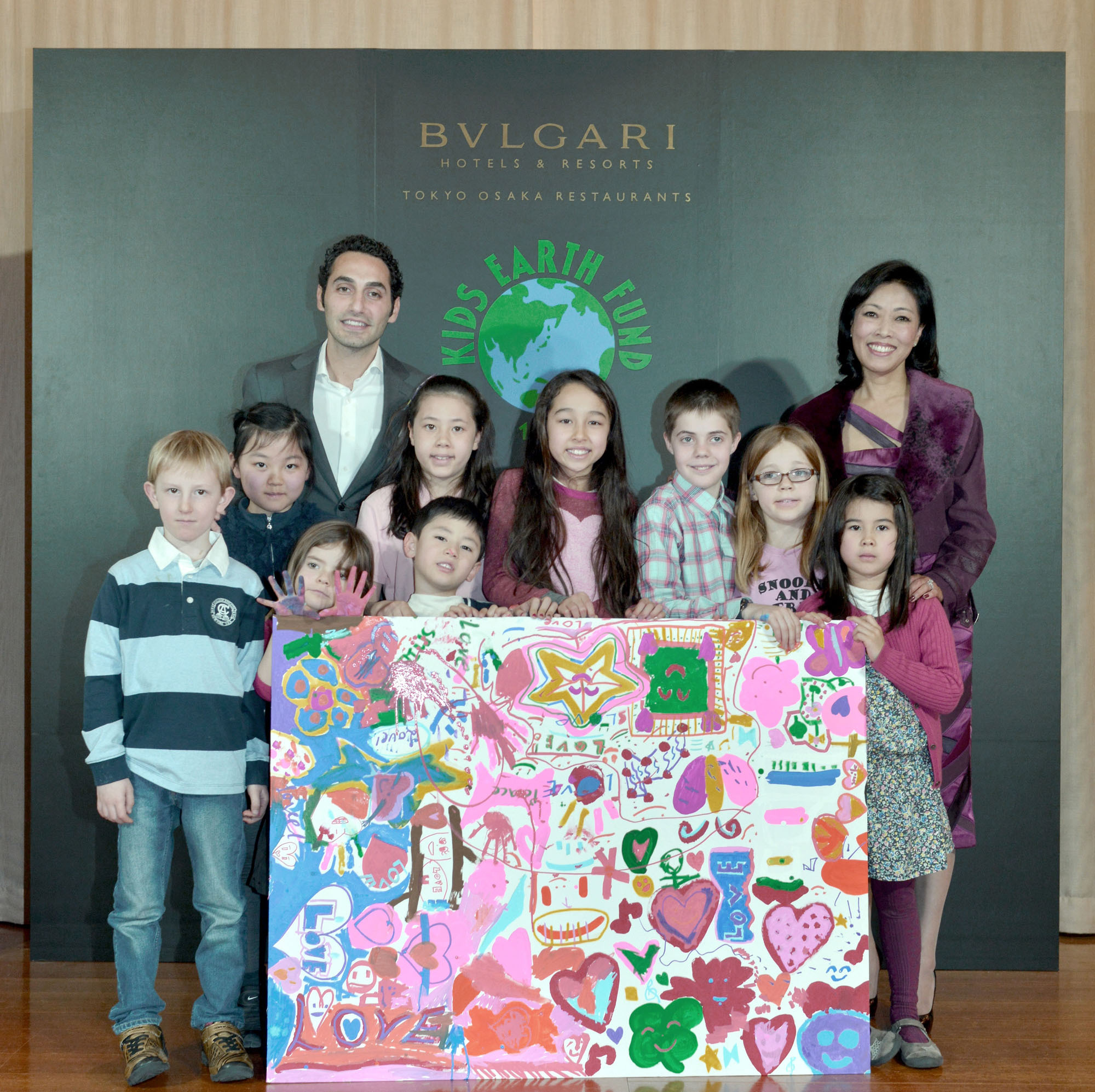 General Manager of Bvlgari Hotels & Resorts, Tokyo-Osaka Restaurants, Goffredo Dell' Appennino (back row, left), and Harumi Torii (back row, right), founder of the Kids Earth Fund, pose with children at an event announcing that a portion of the sales of chocolate products for Valentine's Day will go to the Kids Earth Fund at the Bvlgari Ginza Tower on Jan. 14. |  BVLGALI HOTELS & RESORTS