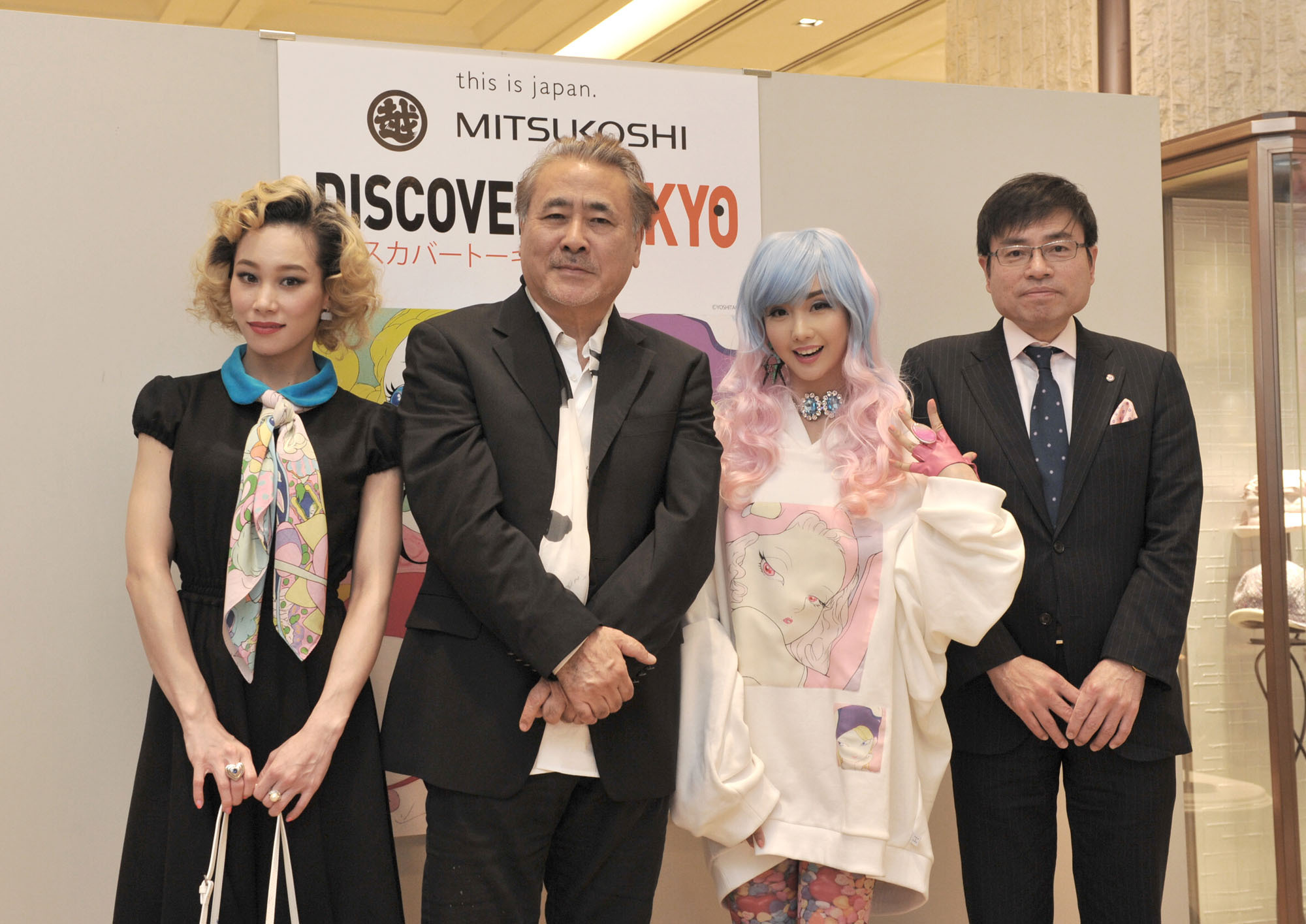 """Japanese pop culture artist Yoshitaka Amano (second from left) poses with (from left) singer Mademoiselle Yulia, artist Alodia and the Executive Officer and General Manager of the Mitsukoshi Ginza store, Makoto Asaka, at the opening ceremony of the """"DISCOVER! TOKYO"""" pop culture and fashion event, which runs until Feb. 16. 
