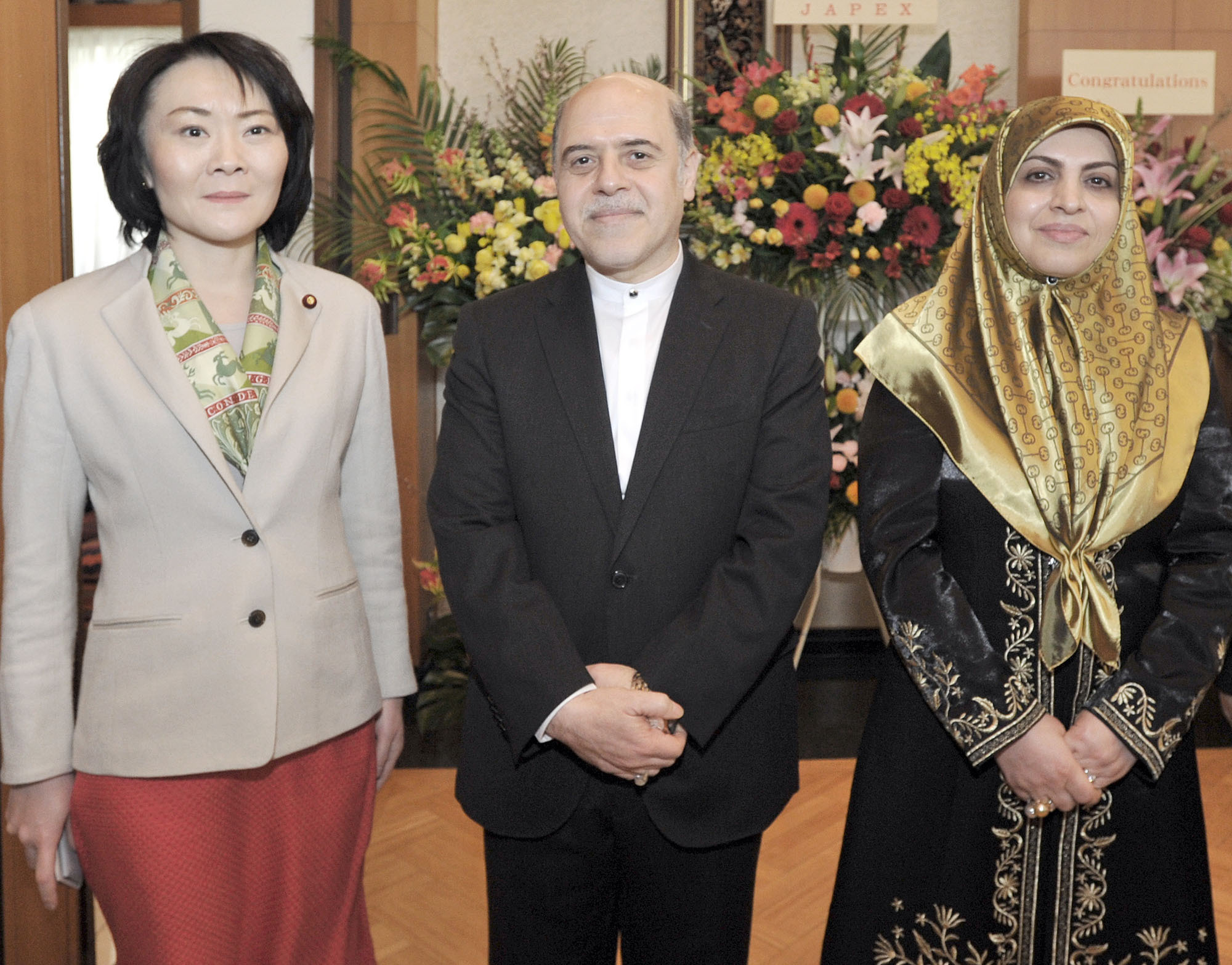 Iran Ambassador Reza Nazar Ahari (center) and his wife Sedigheh (right) welcome Parliamentary Vice-Minister for Foreign Affairs Miki Yamada, during a reception to celebrate the 37th Anniversary of the Islamic Revolution of Iran at the embassy in Tokyo on Feb. 10. | YOSHIAKI MIURA