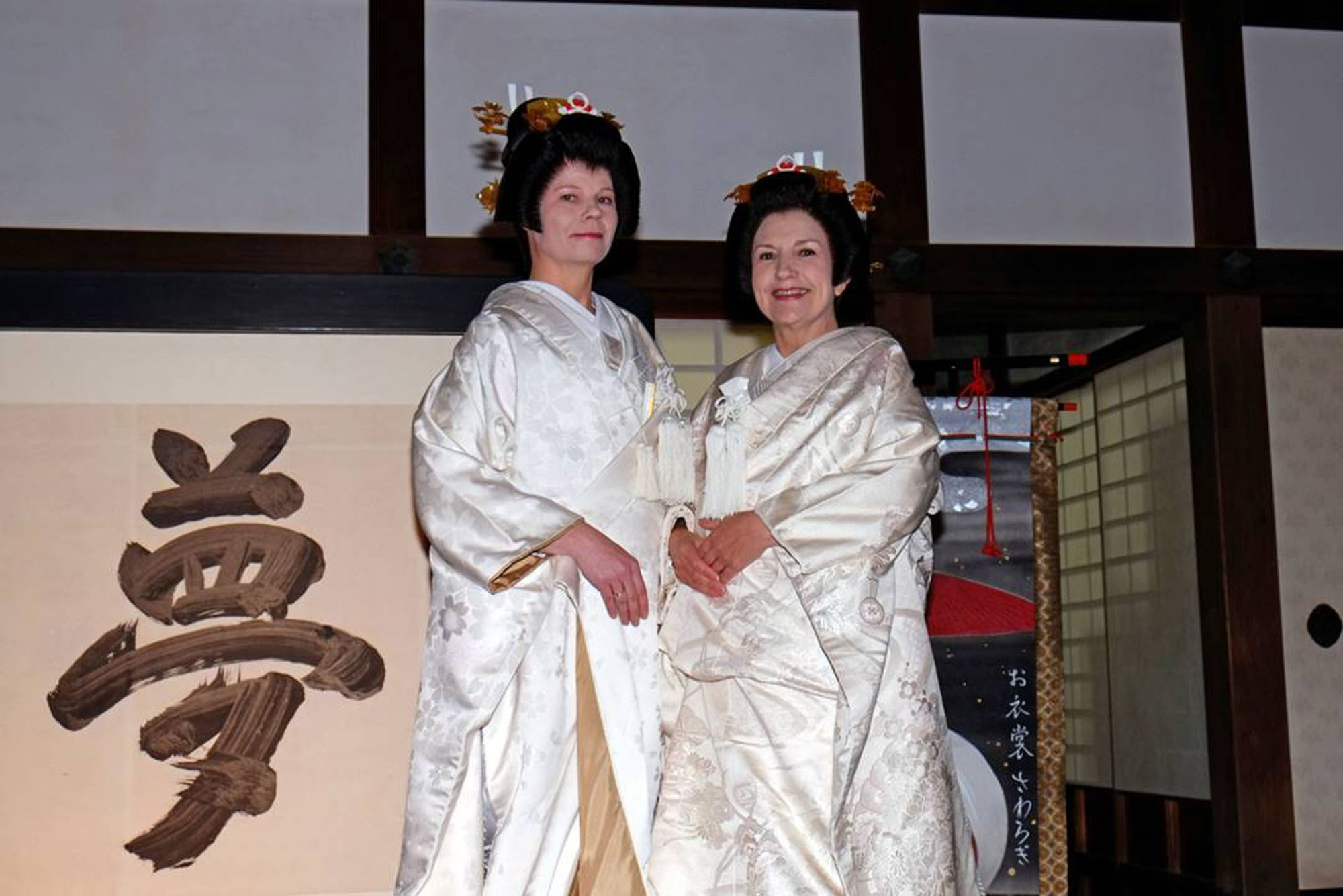 "The ""Kitsune no Yomeiri"" (Wedding Parade of the Foxes), featuring women wearing white kimono and made up to look like foxes, is currently underway in Kyoto. Dace Penke (left), the wife of the Latvian ambassador, and Monica Riquetti Ulloa, the wife of the Uruguayan ambassador, pose in kimono at Kodaji Temple on March 12. The event runs through March 21. 