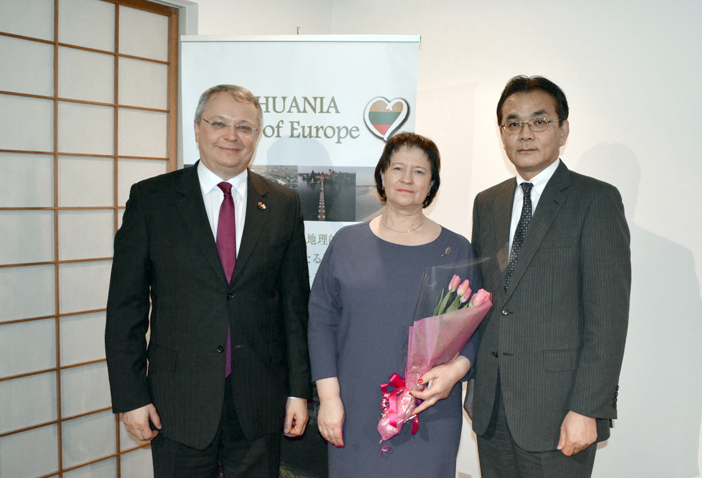 Lithuanian Minister of Agriculture Virginija Baltraitiene (center) poses with Vice Agriculture, Forestry and Fisheries Minister Hiromichi Matsushima (right) and Lithuanian Ambassador Egidijus Meilunas at a presentation promoting Lithuanian agriculture and food products at the Lithuanian Embassy in Tokyo on March 8. | LITHUANIA EMBASSY