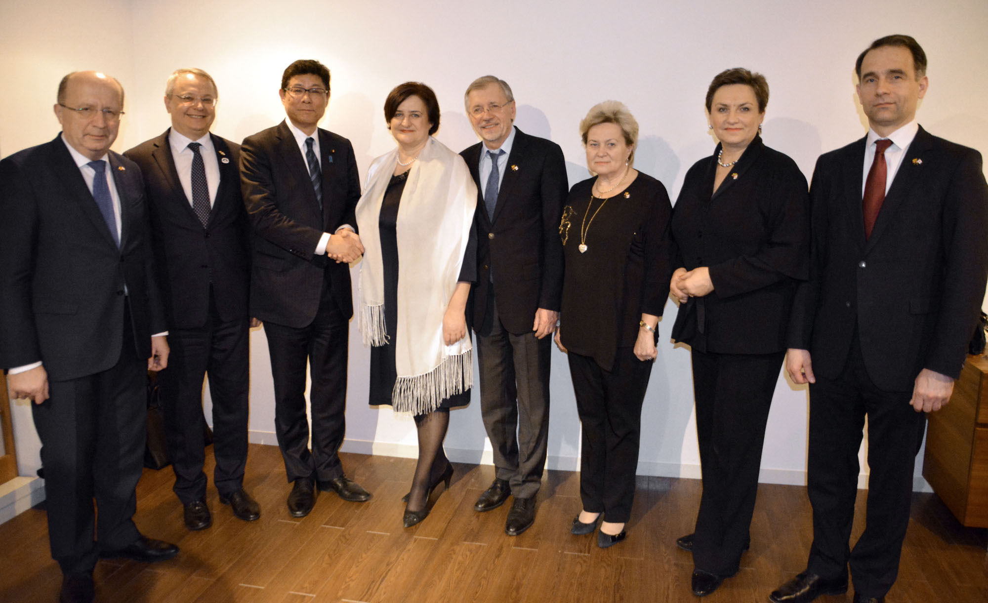 Reconstruction minister Tsuyoshi Takagi (third from left) shakes hands with the Speaker of the Lithuanian parliament Loreta Grauziniene at a reception in her honor at the Lithuanian Embassy on March 2. They were joined by (from left) Andrius Kubilius, former Lithuanian prime minister; Egidijus Meilunas, ambassador of Lithuania; Gediminas Kirkilas, former Lithuanian prime minister; Lithuanian parliament members Irena Siauliene and Dangute Mikutiene; and Minister of Energy Rokas Masiulis. | LITHUANIAN EMBASSY