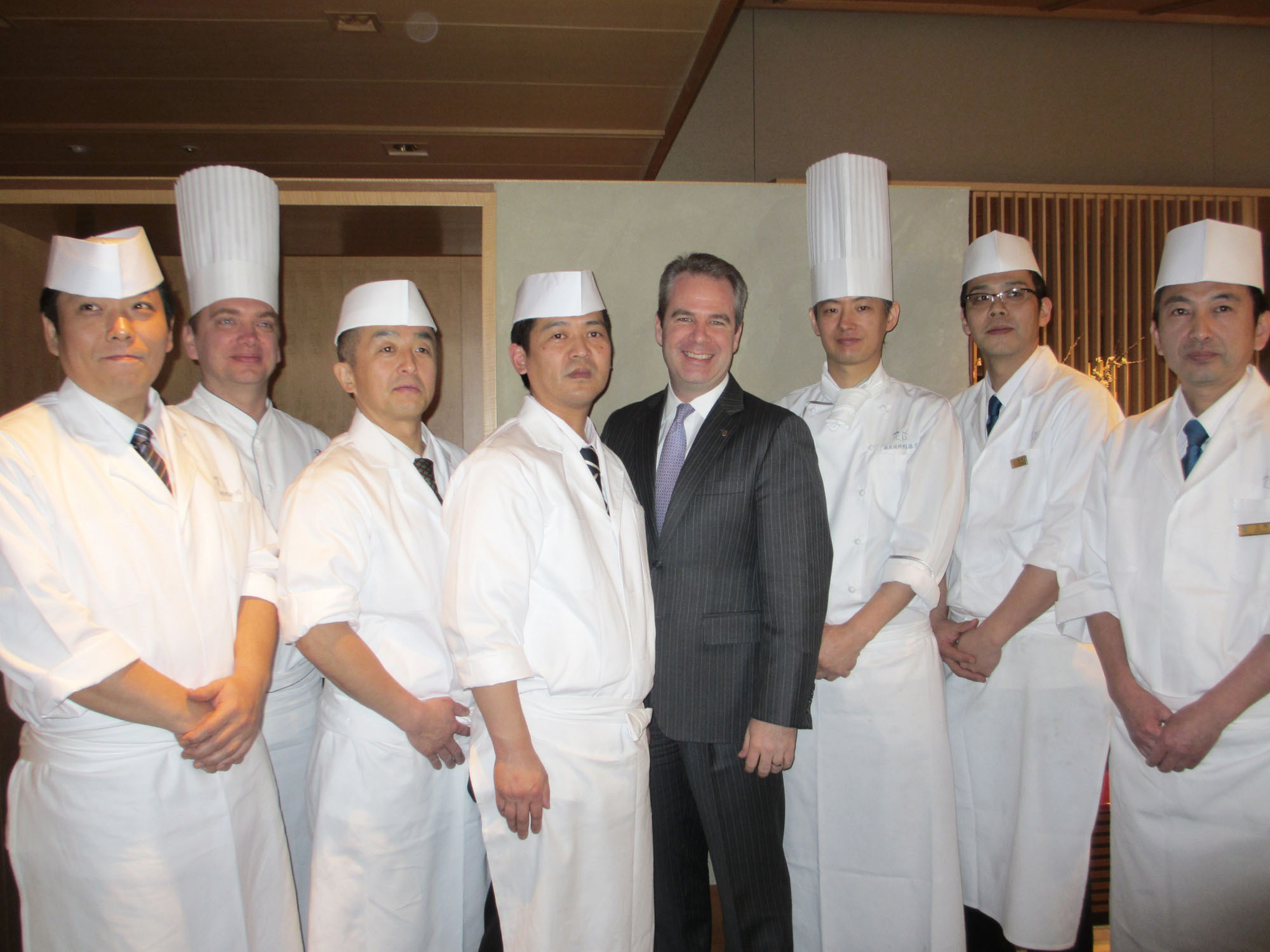 Christopher Clark (fourth from right), general manager of The Ritz-Carlton Osaka, poses with chefs from the Hanagatami restaurant at a press party on March 3, the day before the Japanese restaurant reopened. | HIROKO INOUE