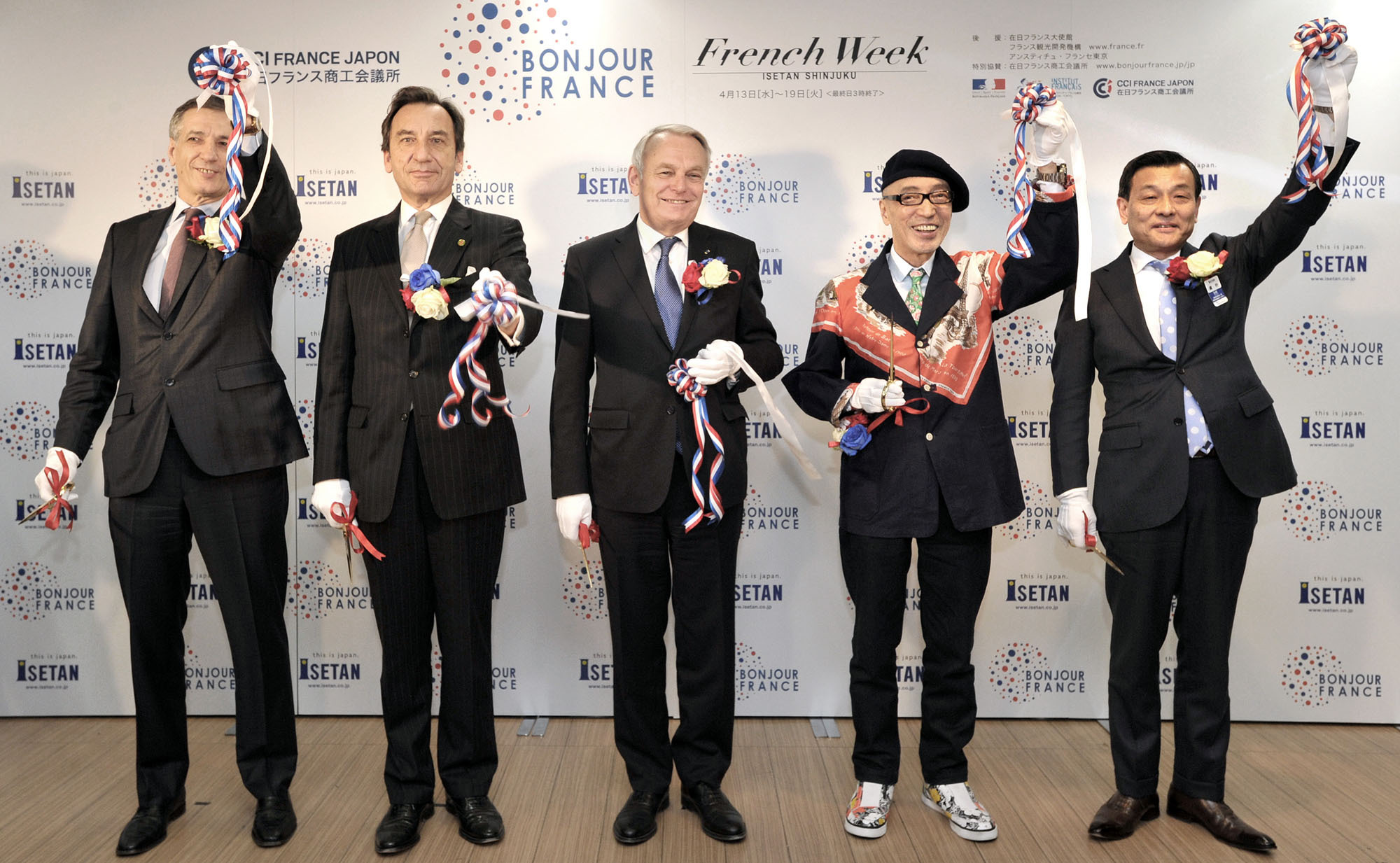 "French Minister of Foreign Affairs and International Development Jean-Marc Ayrault (center) is joined by, from left, French Chamber of Commerce and Industry in Japan President Bernard Delmas; French Ambassador Thierry Dana; DS Ambassador Terry Ito; and Managing Executive Officer and Store Manager of the Isetan Shinjuku Main department store Masaaki Takano at the ribbon cutting for  Mitsukoshi Isetan Holdings' ""Bonjour France, French Week'' event at the Isetan Shinjuku Main store on April 12. 