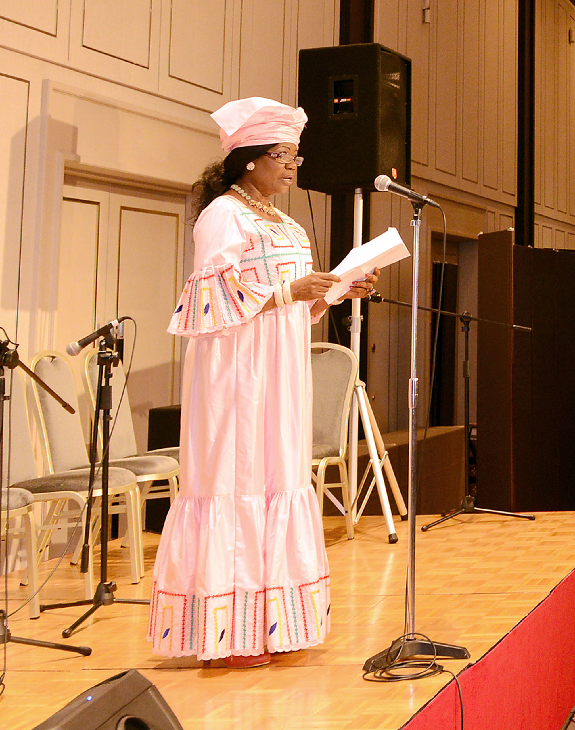 The President of the Association of Wives of African Ambassadors in Japan (AWAAJ), Alphonsine B. Ndzengue, wife of the ambassador of Cameroon, speaks at the association's charity dinner and dance, with proceeds this year going to Fukushima Support Net Sado and other charity organizations in Japan and Africa. | AWAAJ