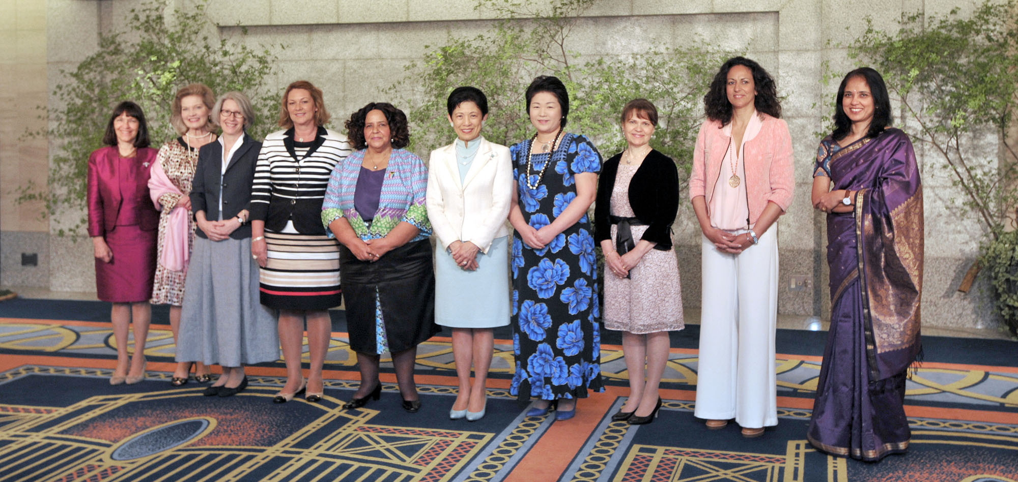 (From left) Malena Mandiola de Gardella, wife of the Argentine chief of mission, poses with ambassadors wives Lise Frederiksen (Denmark); Elizabeth Von Werthern (Germany); Gudrun Margret Solonsdottir (Iceland); South African Ambassador Beryl Rose Sisulu; Princess Takamado; Momoe Fritz (Micronesia); Liisa Viratamo (Finland); Katerina Mathioudaki (Greece); and Vidya Chinoy (India) at the opening ceremony of the 16th Annual World Gardening Fair in Hotel Okura on May 3. The fair runs through May 7. | YOSHIAKI MIURA