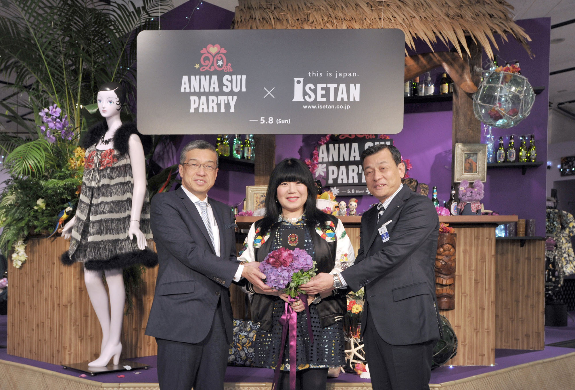 "Designer Anna Sui (center) poses with Hiroshi Ohnishi (left), president and CEO of Isetan Mitsukoshi Holdings Ltd., and Masaaki Takano, Isetan Shinjuku managing executive officer and general manager, to celebrate the 20th anniversary of the designer entering the Japan market during the opening ceremony of the ""ANNA SUI PARTY,"" at the Isetan Shinjuku Main Store on May 4. 