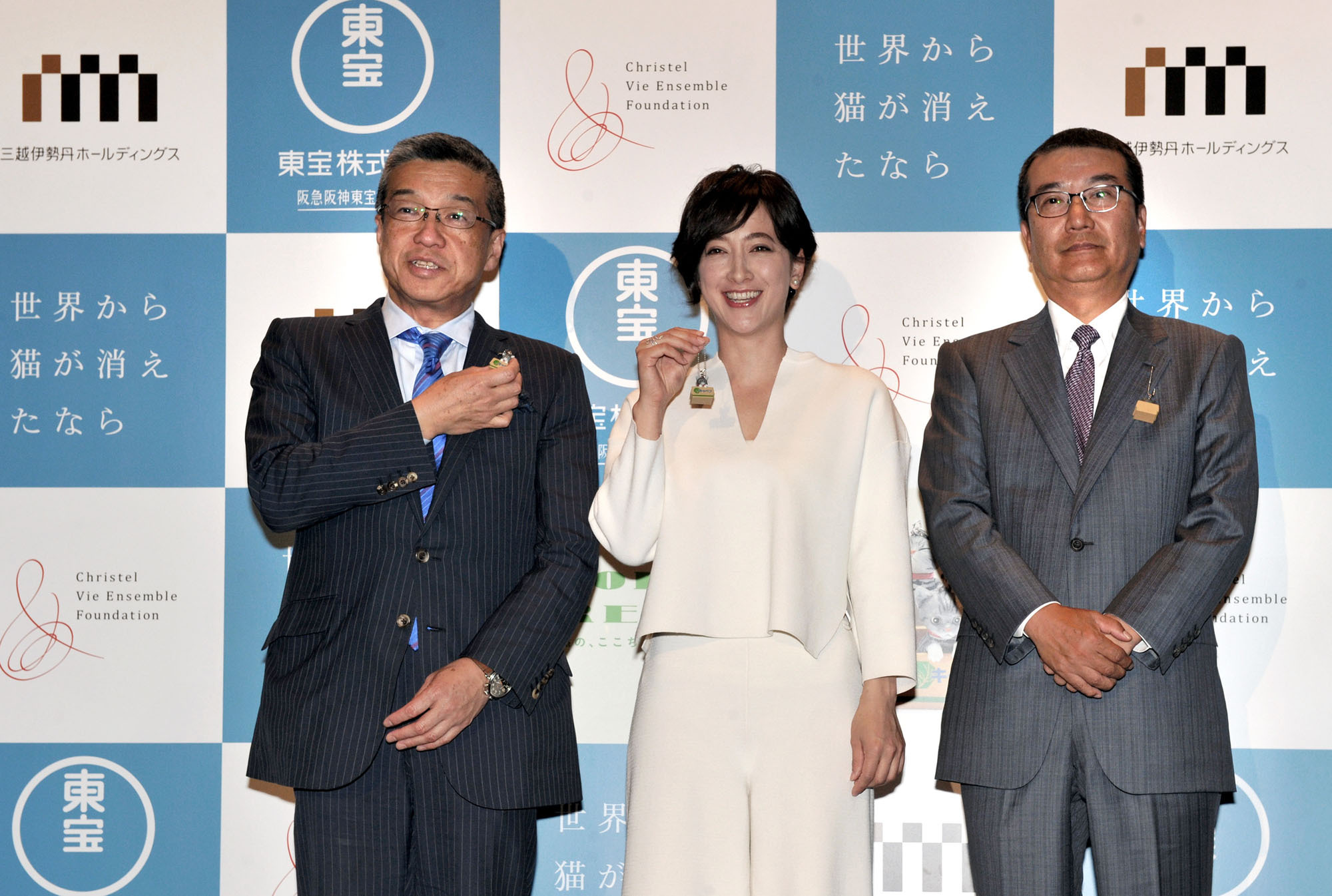 "Christel Takigawa (center), chair of the Christel Vie Ensemble Foundation poses with Hiroshi Ohnishi (left), president and CEO of Isetan Mitsukoshi Holdings Ltd., and Yoshishige Shimatani, president of Toho Co., at the launch of a charity collaboration tied into the movie ""If Cats Disappeared from the World'' during a press conference at the Toho Hibiya Building in Tokyo on May 9. 