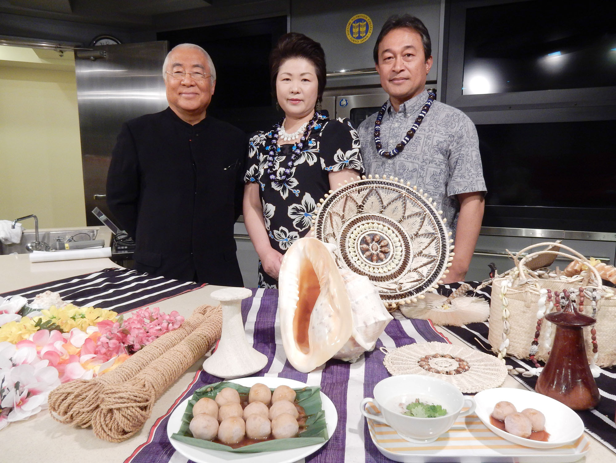 The Ambassador of the Federated States of Micronesia John Fritz (right), his wife Momoe and Yukio Hattori, president of Nutrition College pose following a Micronesian cultural and culinary seminar at Hattori Nutrition College in Tokyo on April 16. | MAKI YAMAMOTO-ARAKAWA