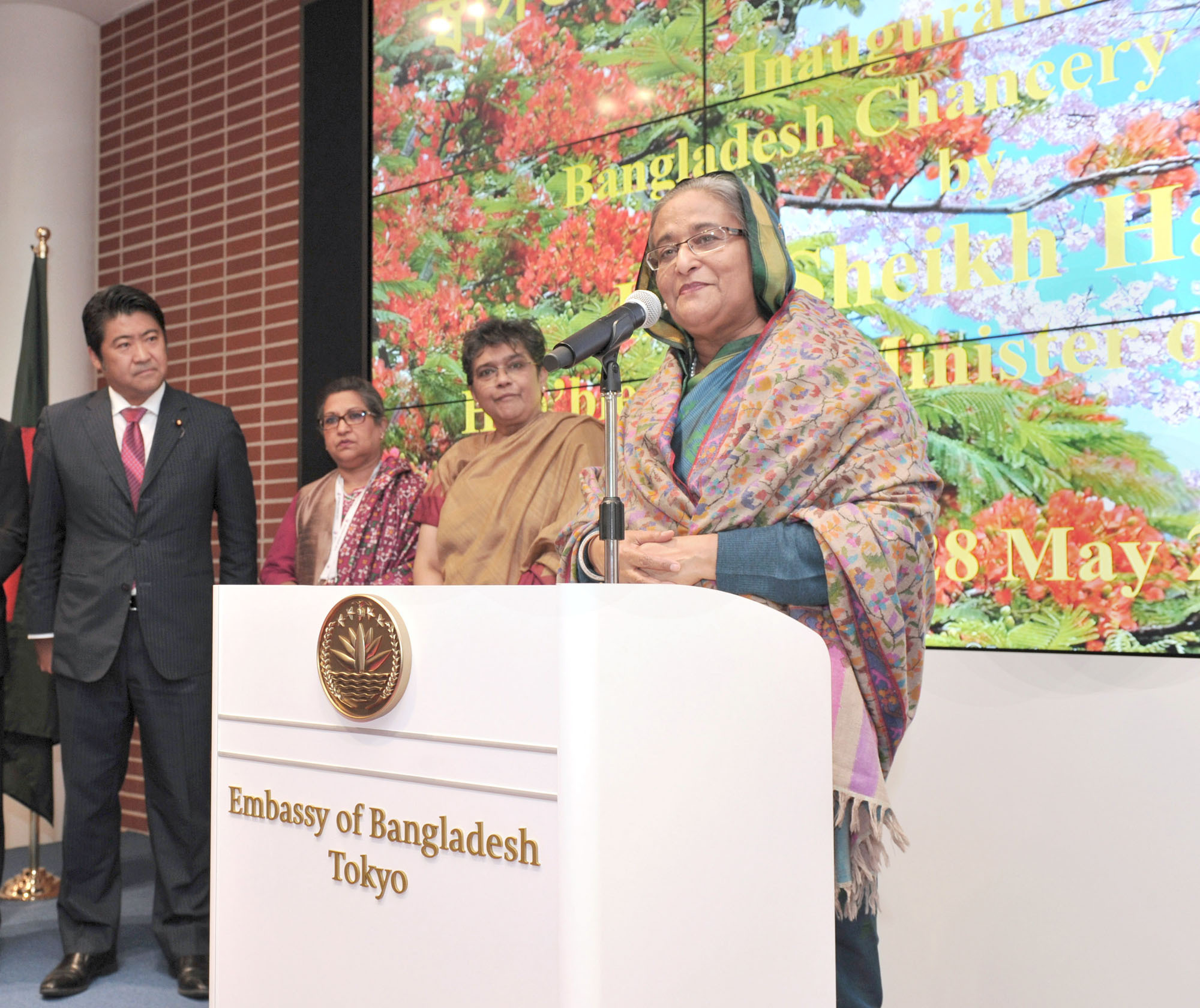 Bangladesh Prime Minister Sheikh Hasina (right), speaks at the opening of the newly constructed Embassy of Bangladesh as State Minister for Foreign Affairs Seiji Kihara (left) and Bangladesh Ambassador Rabab Fatima (second from right) look on at the new embassy in Kioicho, Chiyoda-ku on May 28. |  YOSHIAKI MIURA