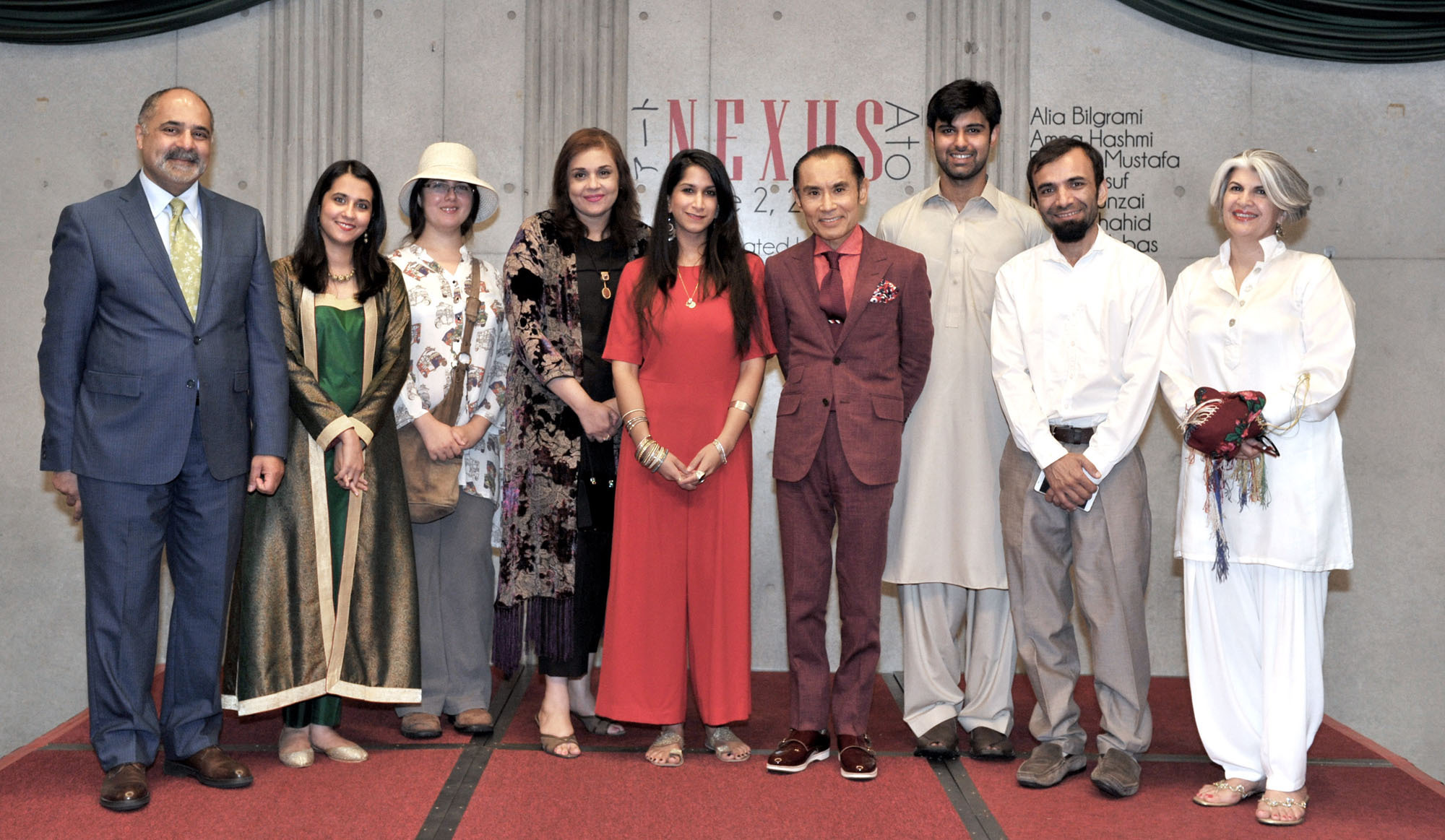 Prominent Pakistani artists (second from left) Alia Bilgrami, Amna Hashmi, Sheherbano Husain, Seyhr Qayum, Jibran Shahid, Imran Hunzai and Ilona Yusuf are joined by Pakistan Ambassador Farukh Amil (left) and actor and special guest Tsurutaro Kataoka (fourth from right) at the Artists-in-Residence art exhibition, which looks to create a fusion between Pakistani and Japanese societies, at the Embassy of Pakistan on June 2. | YOSHIAKI MIURA