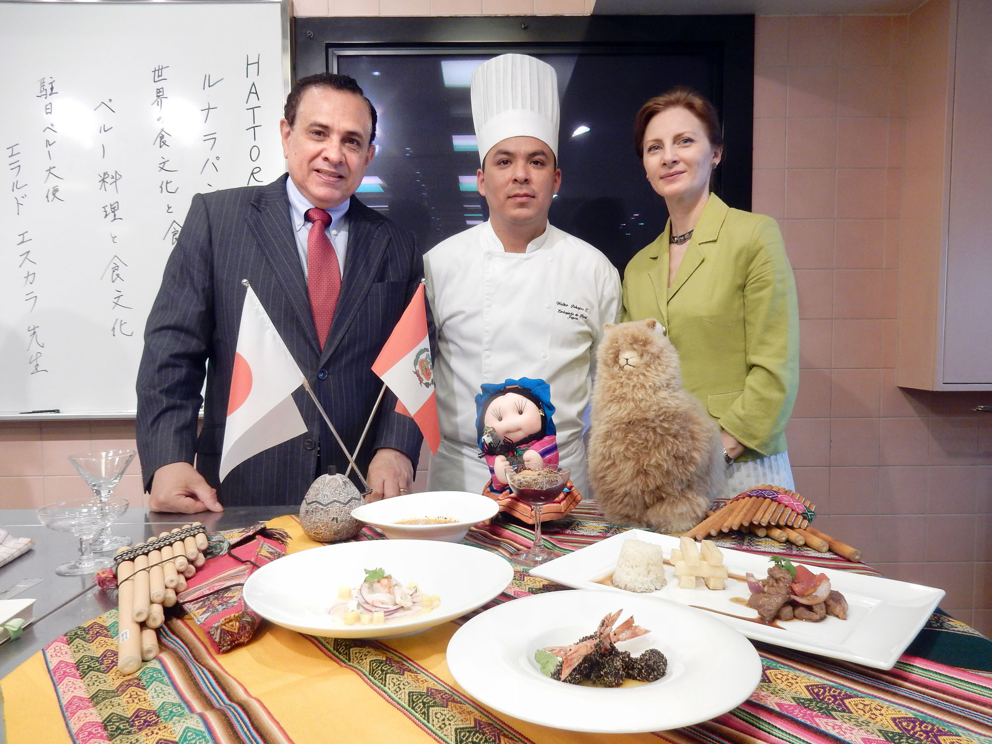 Peruvian Ambassador Elard Escala (left) poses with his wife Cristina and embassy chef Walter Labajos during a Peruvian culinary lesson at the Hattori Nutrition College in Tokyo on June 4. | MAKI YAMAMOTO-ARAKAWA
