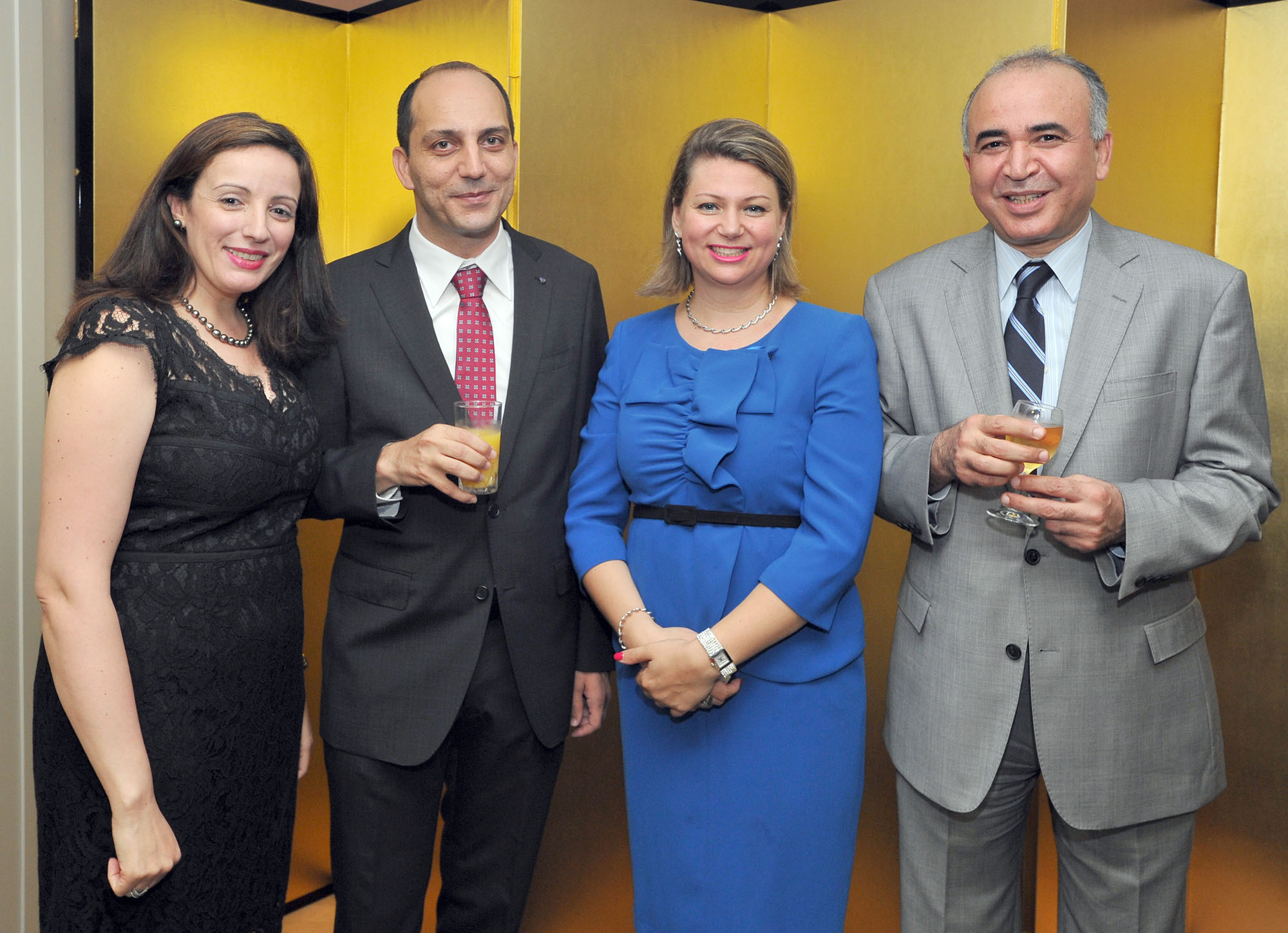 Counsellor and DCM of the Embassy of the Republic of Tunisia Mohamed Elloumi (second from left) and his wife Houda (second from right) are joined by Tunisian Ambassador Kais Darragi (right) and his wife Wided (left) during a farewell party for Elloumi at the ambassador's residence in Tokyo on July 11. |  YOSHIAKI MIURA