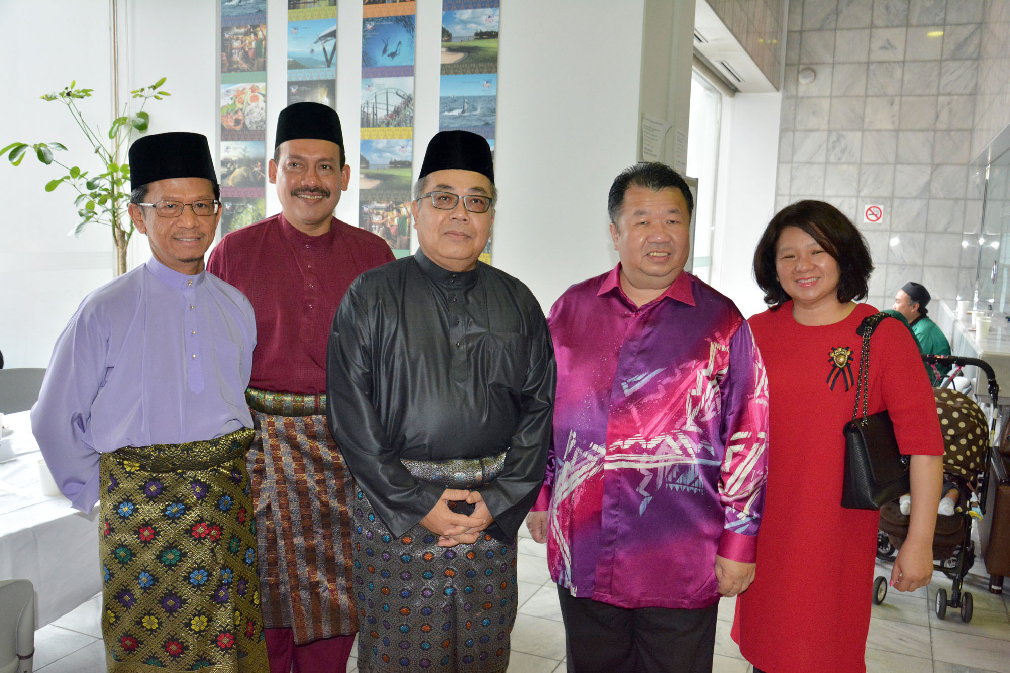 From left: Ambassador of Brunei to Japan Mahamud Ahmad; Director of Tourism Malaysia in Japan Noor Azlan Abu Bakar; Ambassador of Malaysia to Japan Dato' Ahmad Izlan Idris; CEO of Eitoshin Shoji Co. Datuk Seri Tam Yun Tong; and Director of Eitoshin Shoji Co. Datin Seri Ang Hui Chin pose at an event to celebrate the Eid al-Fitr festival at the Malaysian Embassy in Tokyo on July 6. |  EDLEEN OTHMAN