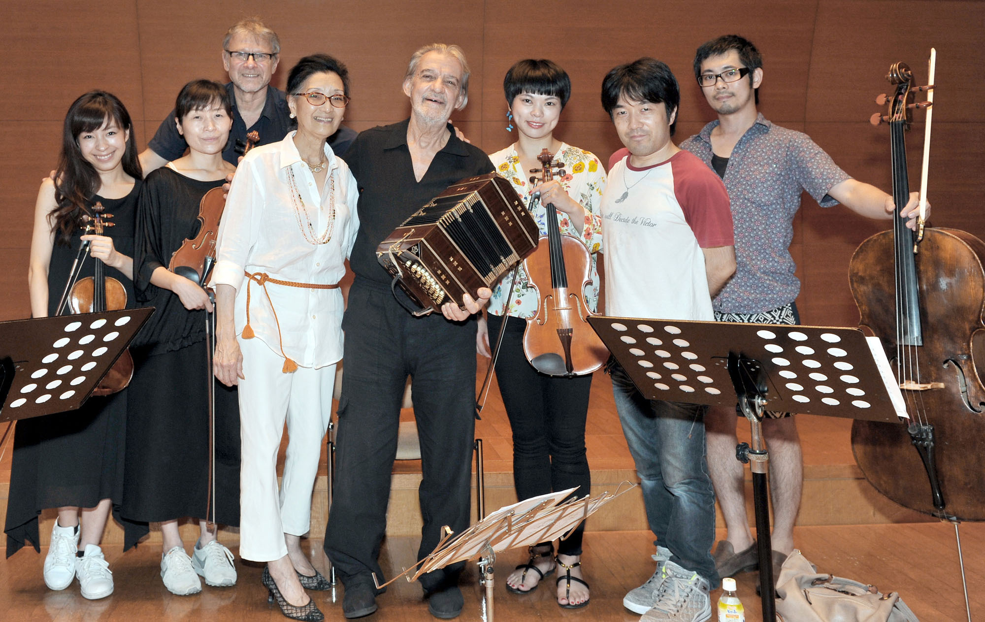 Argentine bandoneonist Rodolfo Mederos (fourth from right) and Argentine Society of Music Authors and Composers Japan representative Hiroko Matoba (fifth from right) pose with Japanese musicians (from left) Tsukasa Kasuya; Momoko Aida; Izumi Kawamura; bandoneonist Ryota Komatsu; Takahiro Uchida; and Mederos' manager Gustavo Frojan (back row) following a rehearsal for a joint concert to celebrate the Bicentennial of the Independence Day of the Argentine Republic at Keyaki Hall at the Koga Masao Museum of Music in Tokyo on July 12. | YOSHIAKI MIURA