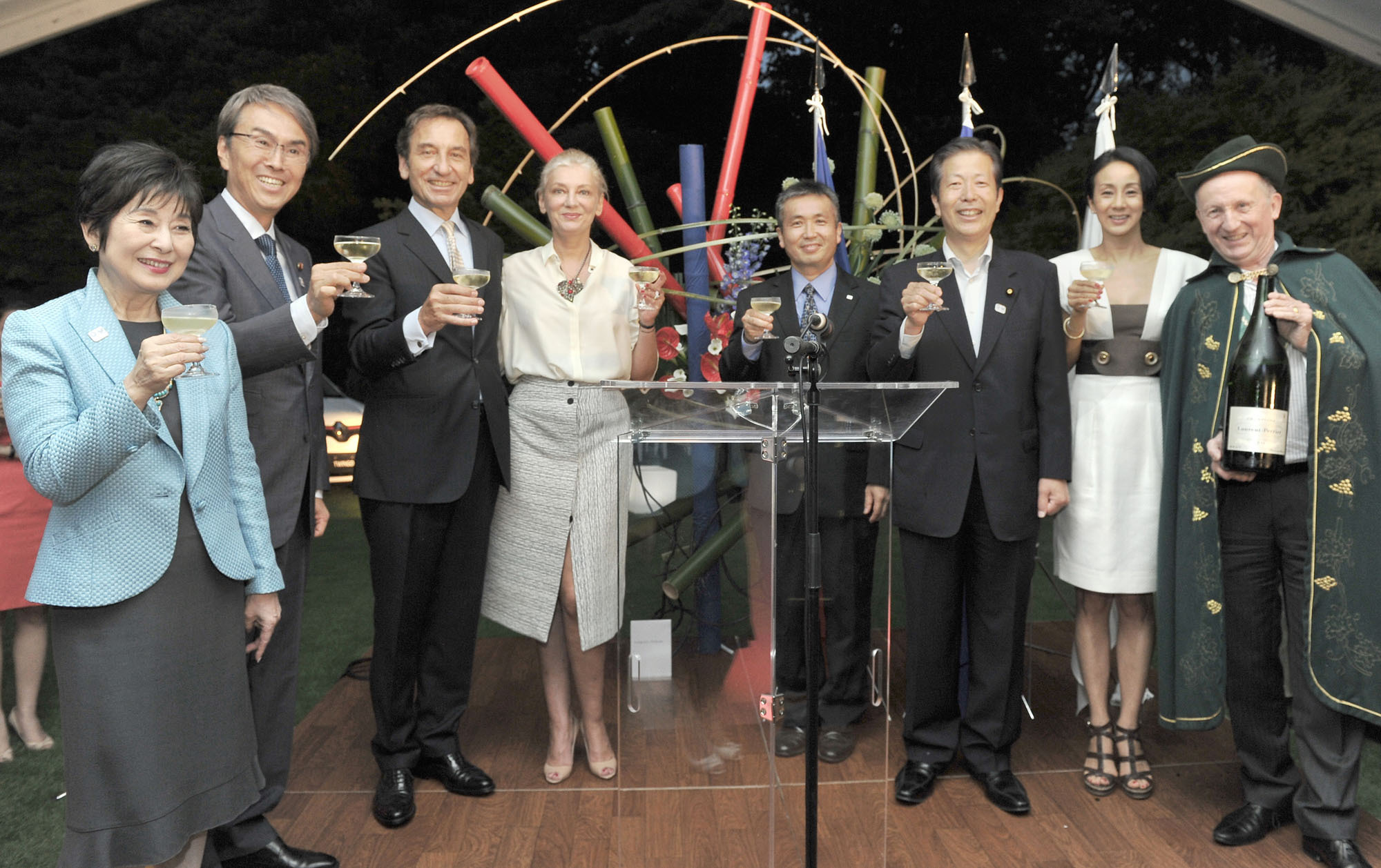 French Ambassador Thierry Dana (third from left) and his wife Florence Godfernaux (fourth from left) raise their glasses with, from left, former House of Councillors Vice President Akiko Santo; economic revitalization minister Nobuteru Ishihara; astronaut Koichi Wakata; Komeito President Natsuo Yamaguchi; France 2016 Sightseeing Ambassador Eriko Nakamura; and Laurent-Perrier Champagne Brand Ambassador Philippe Sauzedde during a reception celebrating the country's National Day at the ambassador's residence in Tokyo on July 14. | YOSHIAKI MIURA
