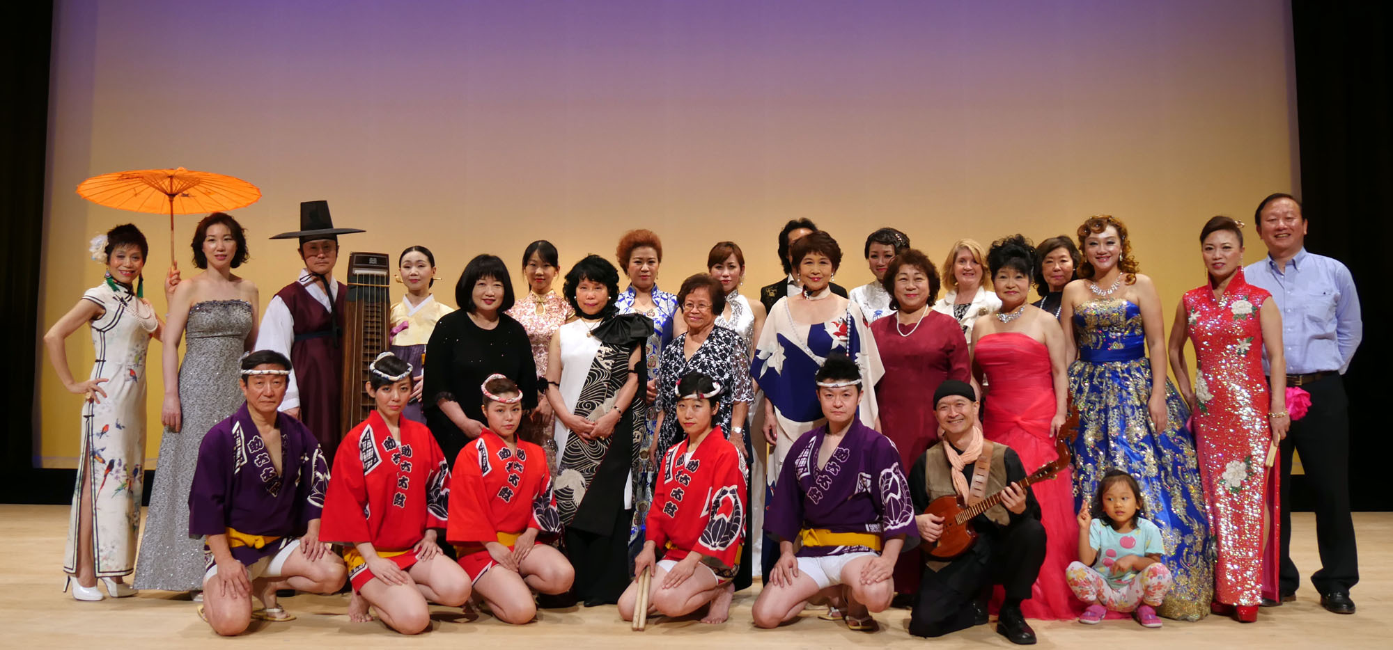 Performers, organizers and supporters of the 25th Annual Kishiko International Concert — Contemporary Piano, Vocal and Traditional Musical instrument Concert from Korea, China, Japan, U.S.A.and Thailand — pose at the curtain raising ceremony at Iino Hall in Tokyo, on July 11. Organized by Worldject International Music NPO and supported by the embassies of Korea, China, Thailand and the United States, the American Center Japan, The Japan Times, Tokyo Beijing International Cultural Communication Association and the Nippon Taiko Foundation Hanna-Chopan, the event saw opening remarks by Chinese Embassy Counselor Cheng Zeng on behalf of the diplomatic corps in Tokyo. Wishing for world peace and friendship, Worldject Chairperson Kishiko Kawaguchi (fifth from left, center row) donated a portion of ticket sales to Zeng; Yupadee Bunnag; spouse of the Thai Ambassador; and Masako Kuriyama, vice-president of the Smart Senior Council of Japan for their charitable activities. | WORLDJECT INTERNATIONAL MUSIC NPO