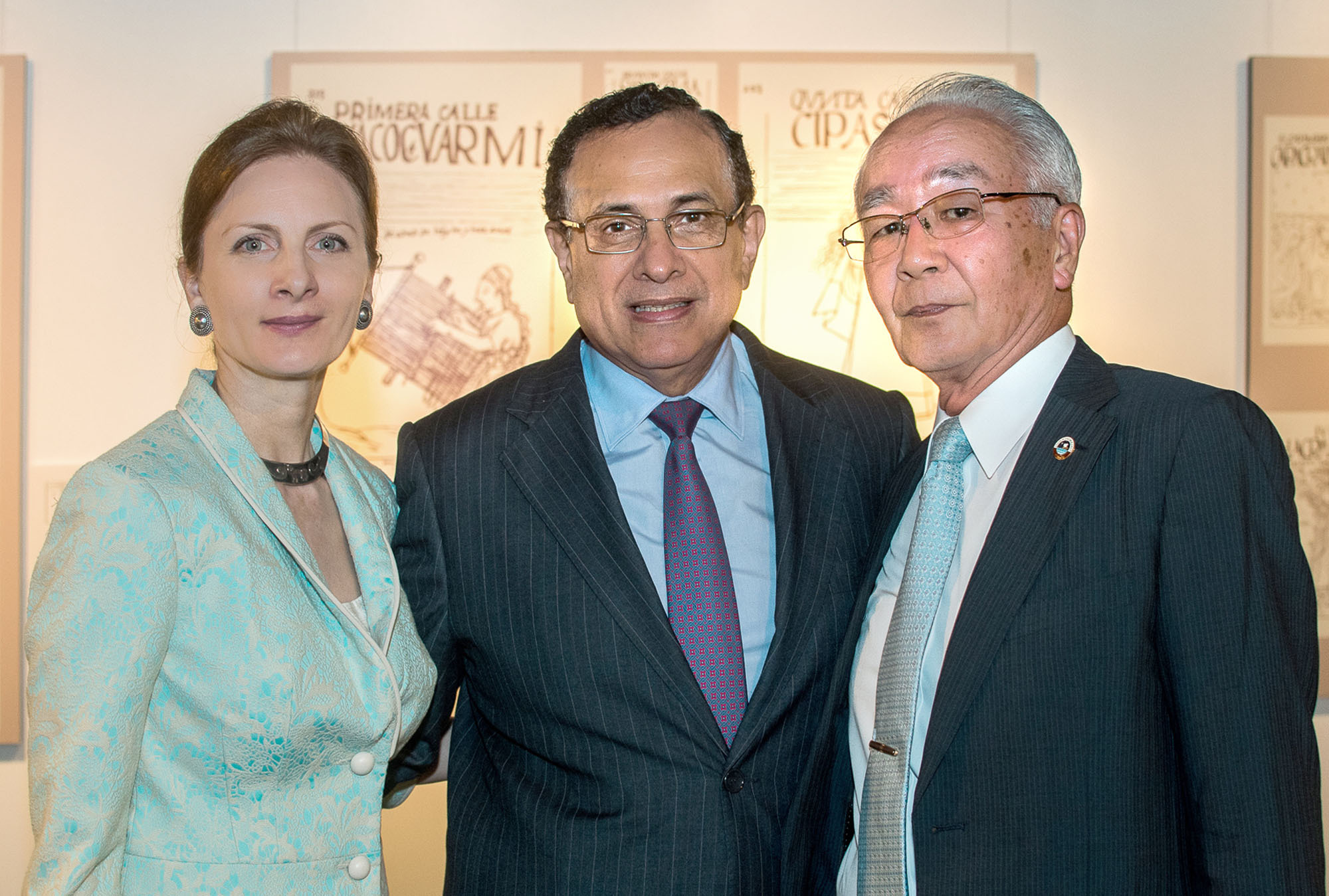 Peruvian Ambassador Elard Escala (center) and his wife Cristina pose with guest speaker Hidefuji Someda, professor emeritus of Osaka University, during the opening of an exhibition of author Guaman Poma de Ayala at Institute Cervantes Tokyo on July 7. The exhibition runs until Aug. 23. | PERUVIAN EMBASSY