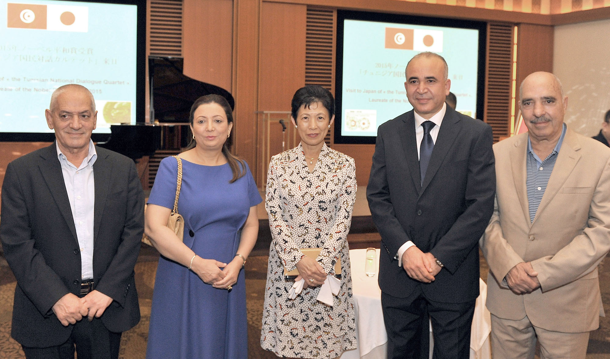 Princess Takamado (center) poses with members of the Tunisian National Dialogue Quartet, the winners of the 2015 Nobel Peace Prize, (from left) Tunisian General Labor Union Secretary-General, Hassine Abassi; Tunisian Confederation of Industry, Trade and Handicrafts President Wided Bouchamaoui; Ambassador of Tunisia in Japan Kais Darragi; and Tunisian Human Rights League President Abdessattar Ben Moussa at a reception in their honor at the Peninsula Hotel Tokyo on July 22. | YOSHIAKI MIURA
