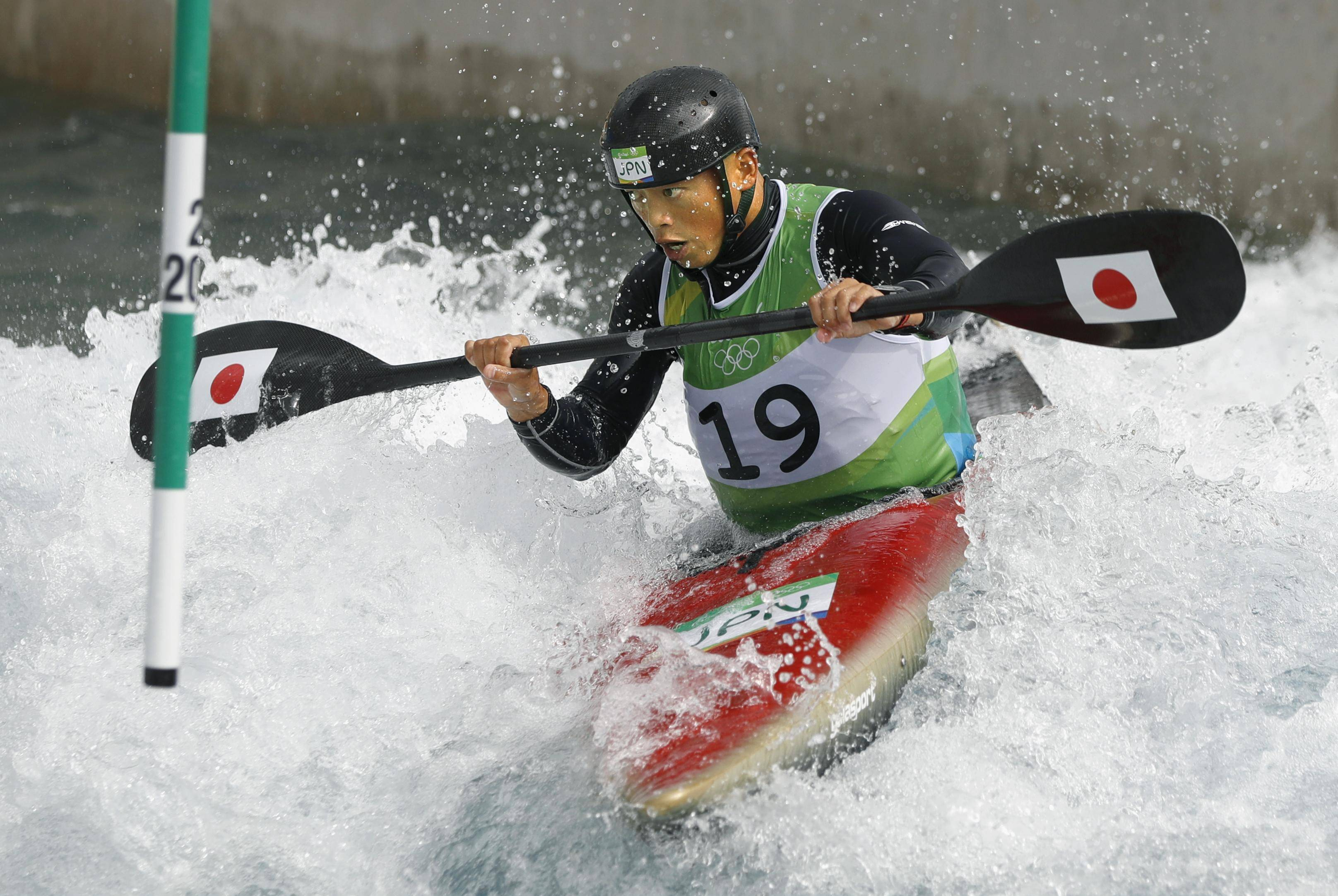 Buddhist priest Kazuki Yazawa competes during the kayak (K1) men's heats of the Canoe Slalom at the 2016 Summer Olympics in Rio de Janeiro on Sunday. | KYODO