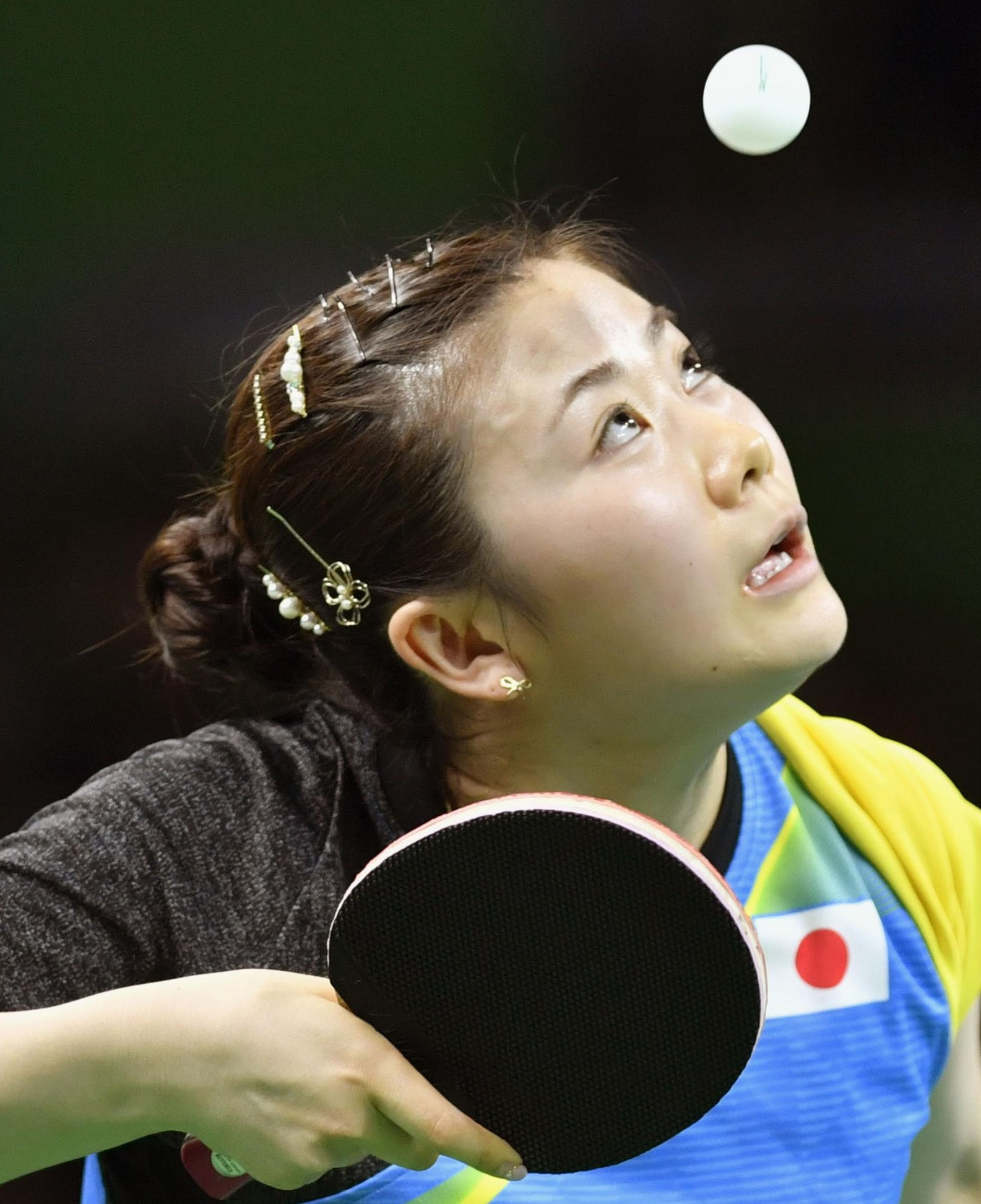 Ai Fukuhara gets ready to serve during her fourth-round match against North Korea's Ri Myong Sun on Monday at the 2016 Rio de Janeiro Games. | KYODO