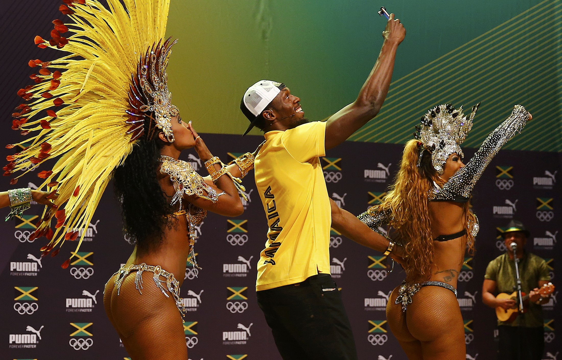 Jamaican track star Usain Bolt dances the samba at a press conference on Monday at the 2016 Summer Olympics in Rio de Janeiro. | REUTERS