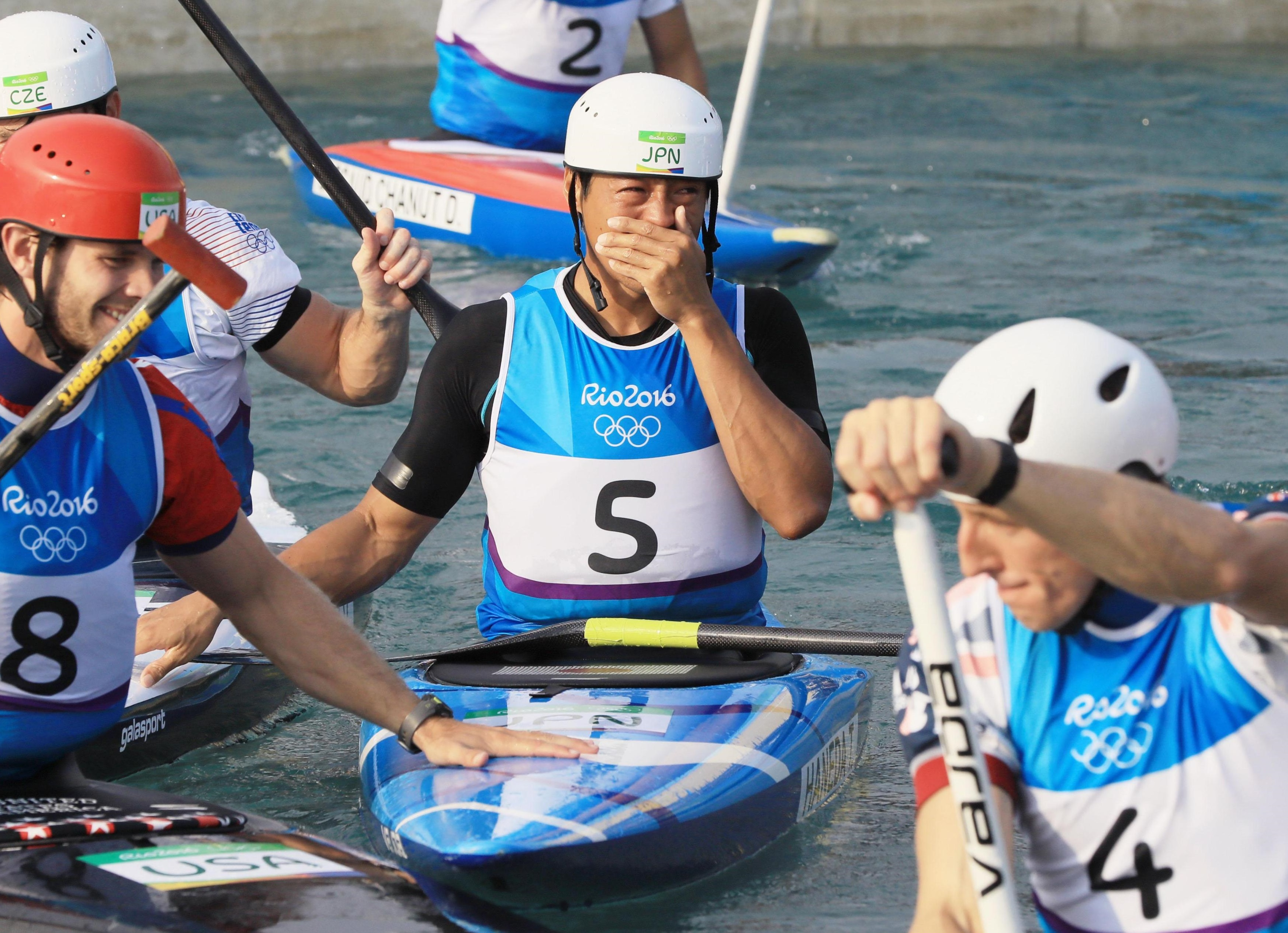 Japan's Takuya Haneda reacts after he earned the bronze medal in the men's canoe slalom at the Rio de Janeiro Olympics on Tuesday. He became the first-ever Japanese Olympic medalist in the sport. | KYODO