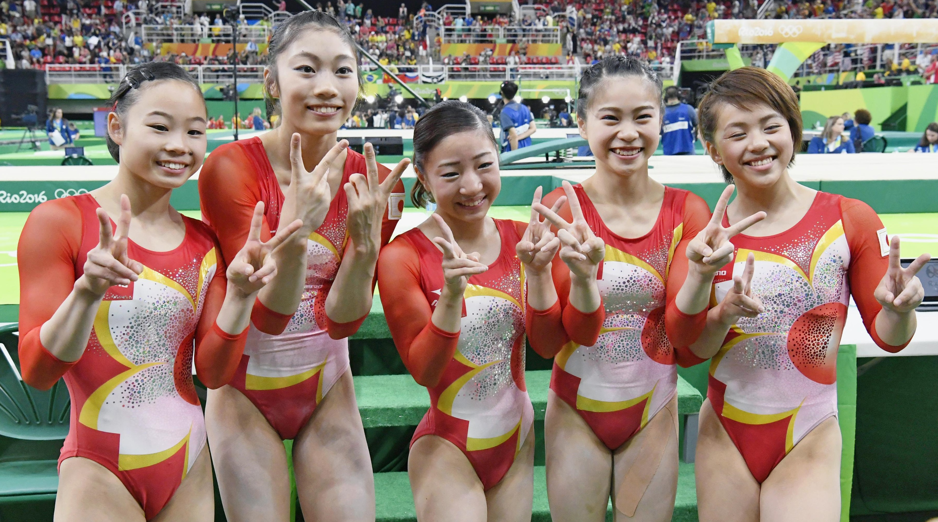 Japanese gymnasts pose for a photo after they finished fourth in the team final at the Rio de Janeiro Olympics on Tuesday. | KYODO