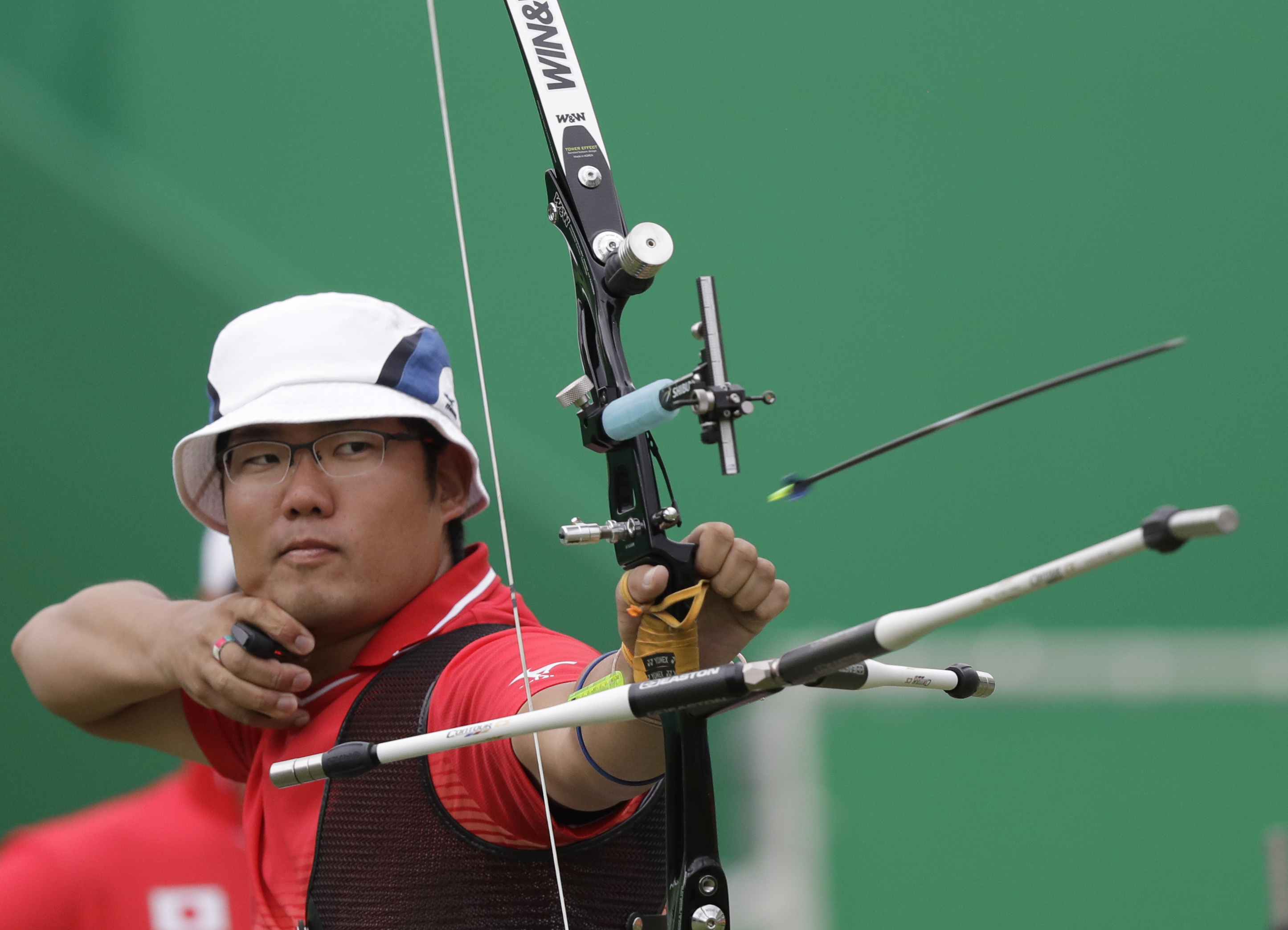 Takaharu Furukawa releases his arrow during an elimination round of the individual archery competition at the 2016 Summer Olympics in Rio de Janeiro on Wednesday. | AP