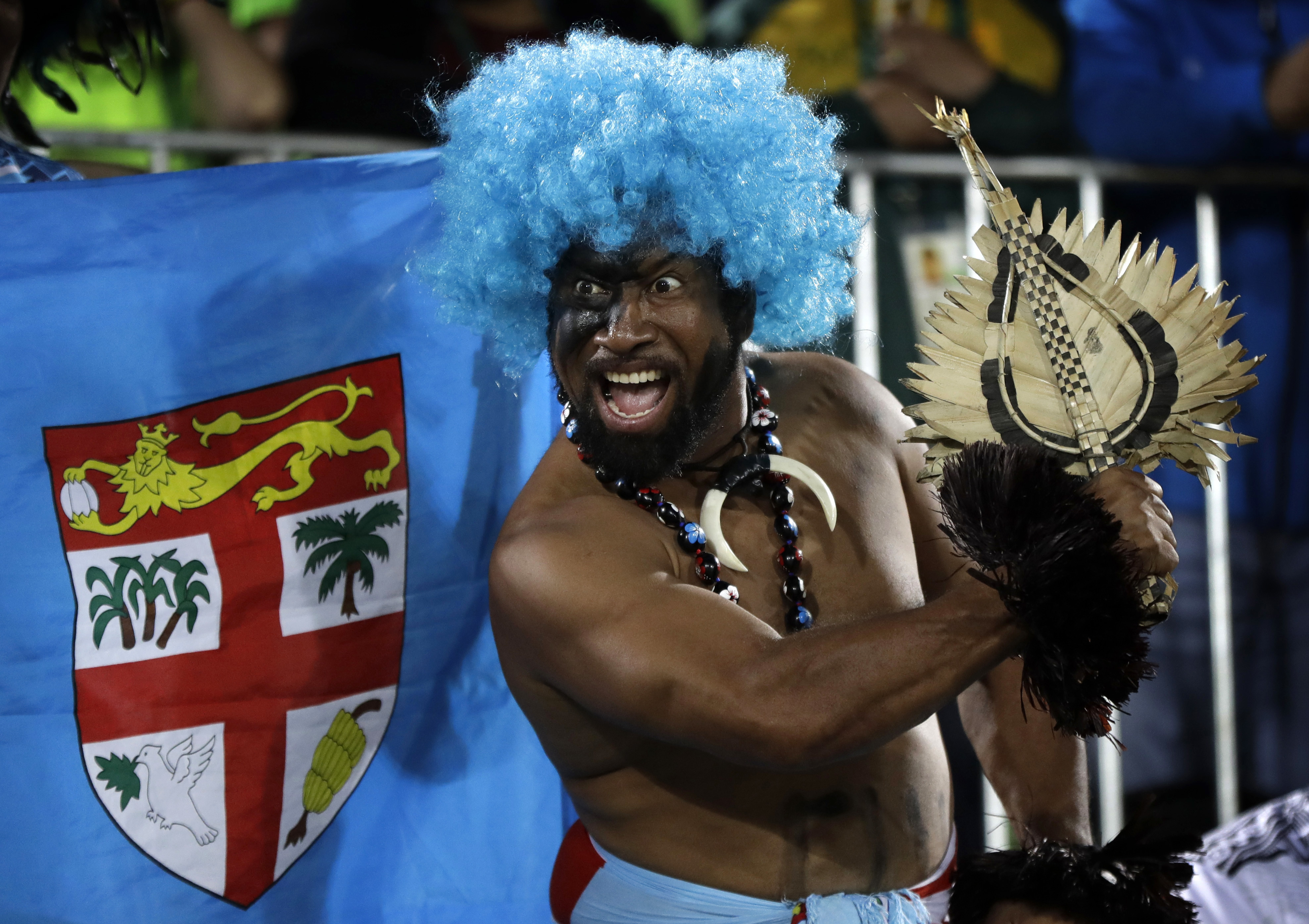 A Fiji fan celebrates his country's gold medal victory over Britain in the men's rugby sevens at the 2016 Summer Olympics in Rio de Janeiro on Thursday. | AP