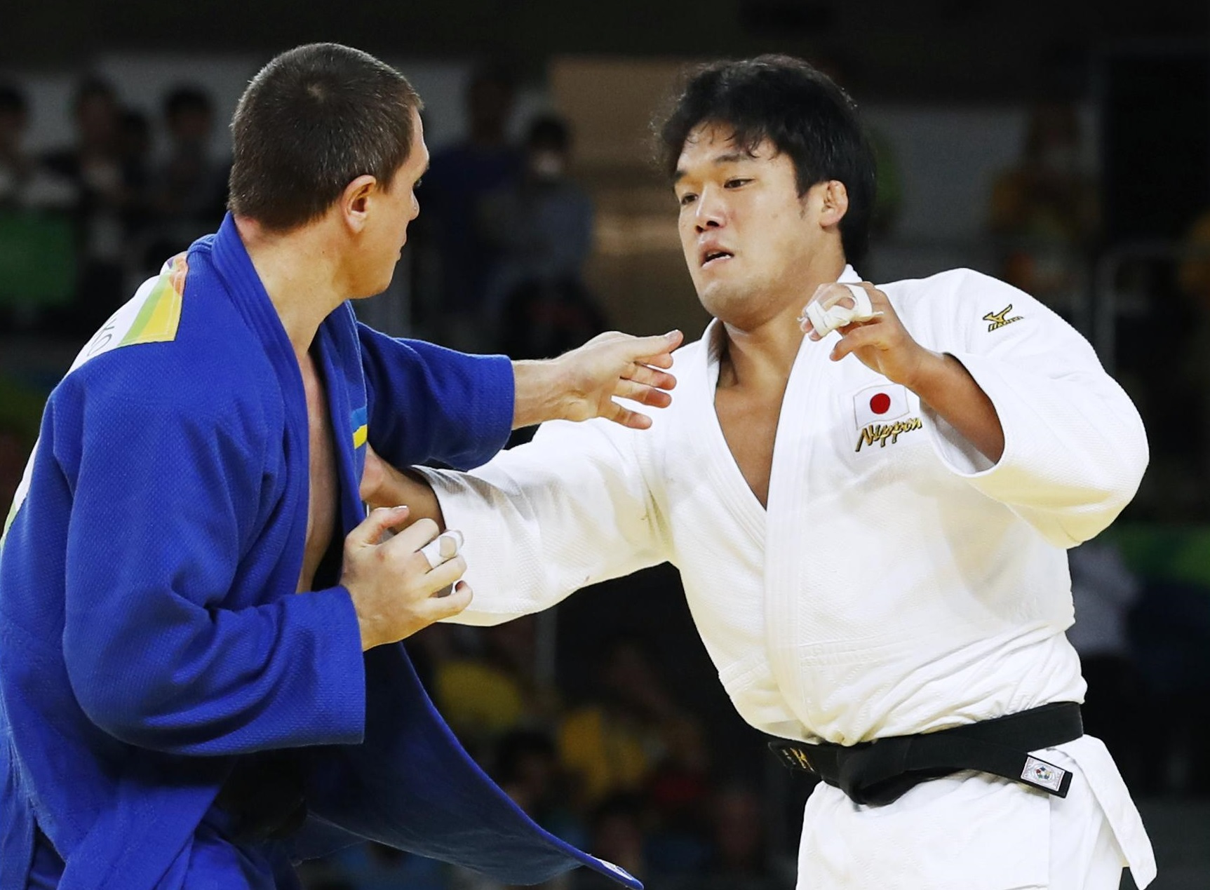 Japan's Ryunosuke Haga competes against Ukraine's Artem Bloshenko in the bronze-medal match of the men's 100 kilograms on Thursday at the Rio de Janeiro Olympics. Haga won the bout. | KYODO