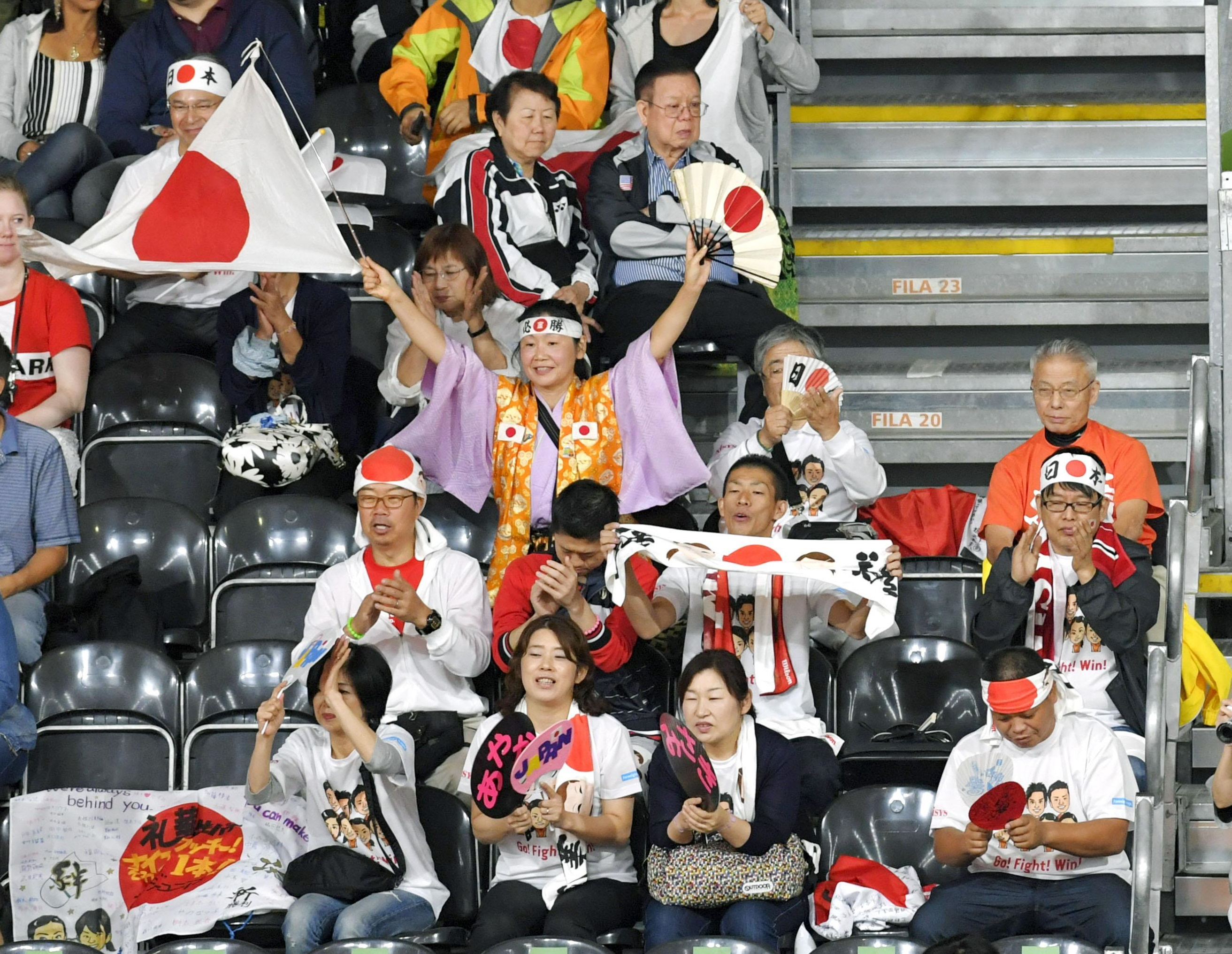 Japanese fans cheer from the stands at the badminton venue at the 2016 Rio de Janeiro Olympics on Friday. | KYODO