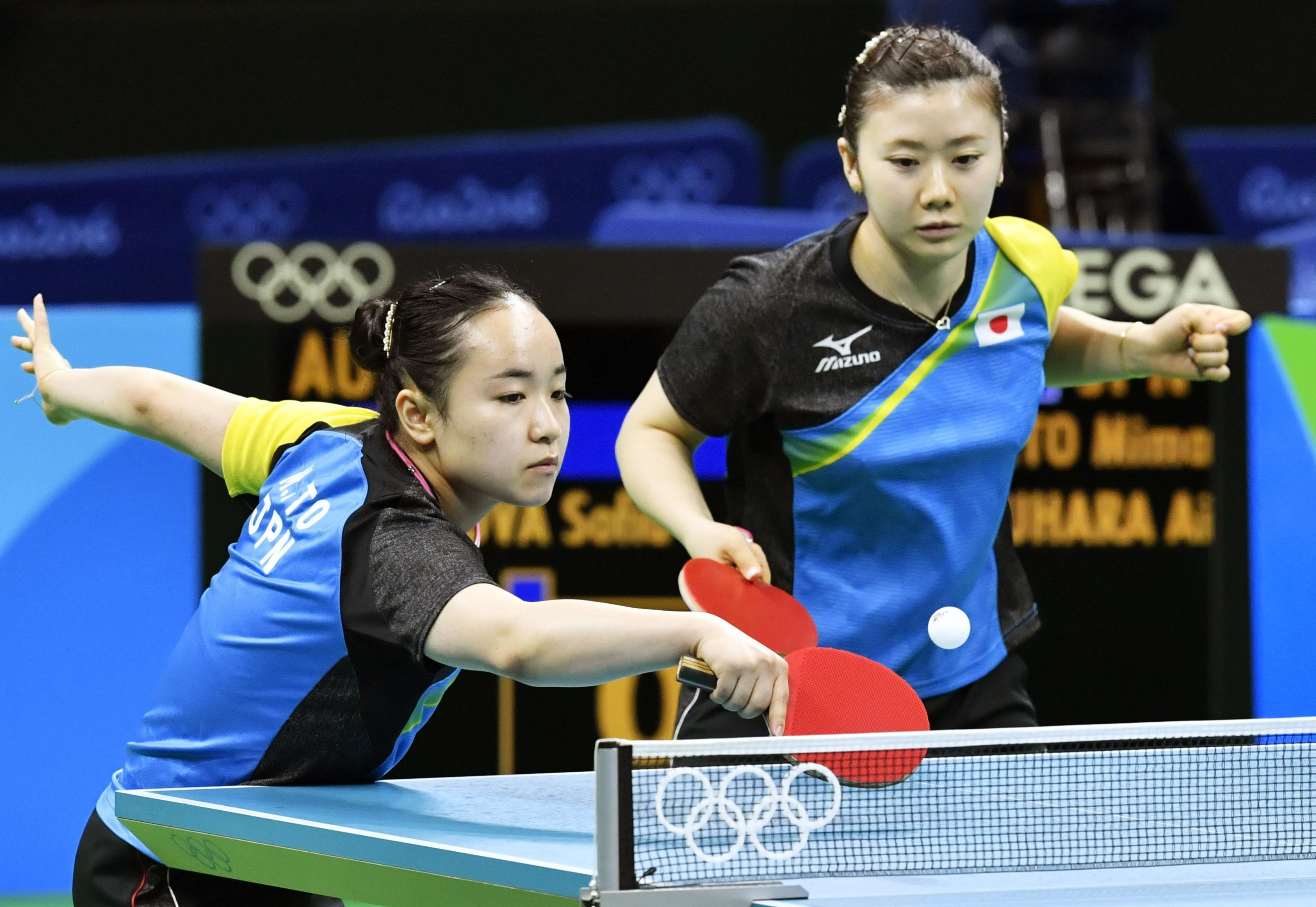 Mima Ito (left), playing with doubles partner Ai Fukuhara, hits a shot during Japan's women's table tennis team quarterfinal match against Austria at the 2016 Rio Olympics on Saturday. | KYODO