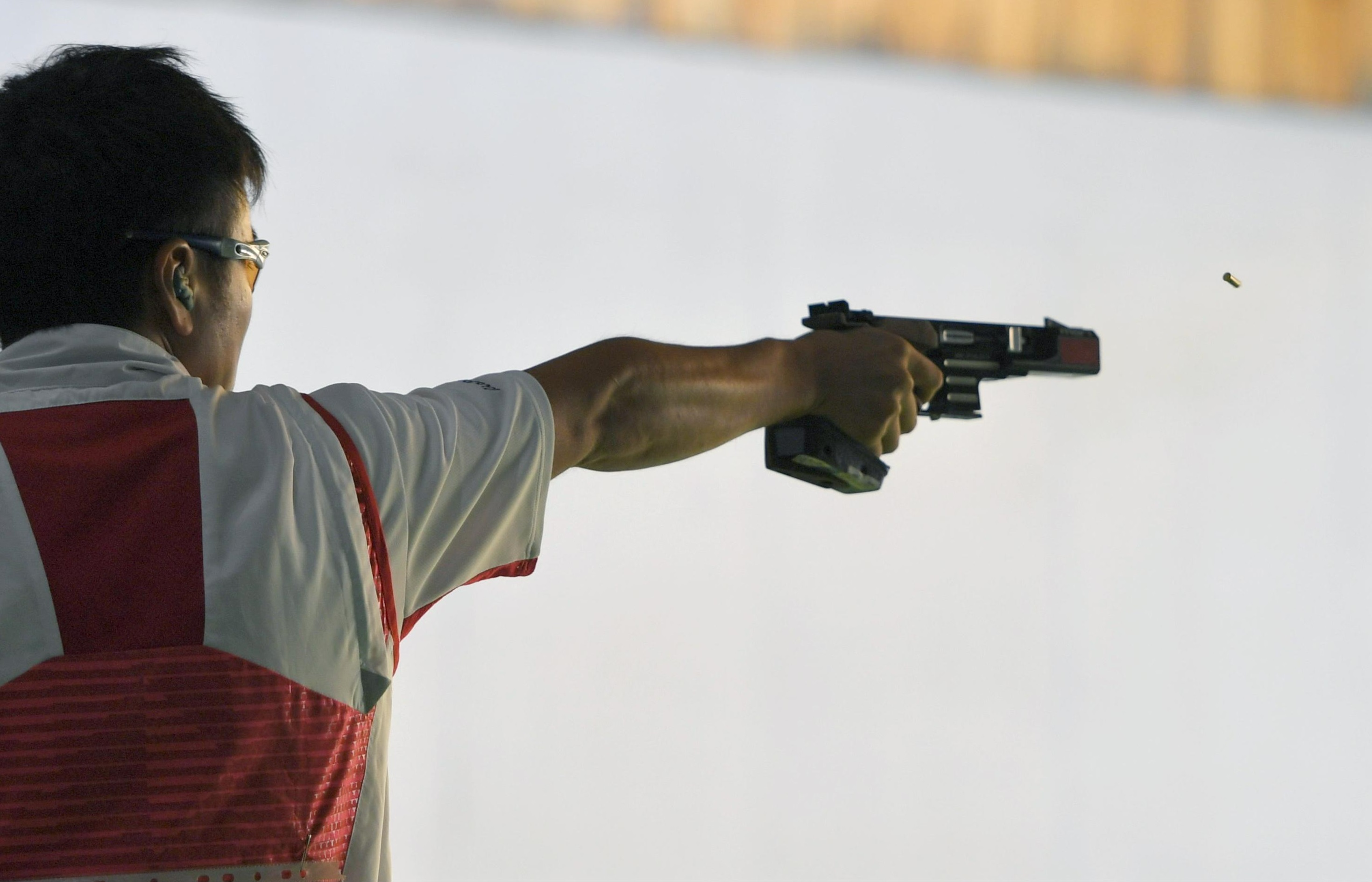 Eita Mori shoots during the men's 25-meter rapid fire pistol qualification round at the 2016 Summer Olympics in Rio de Janeiro. | KYODO