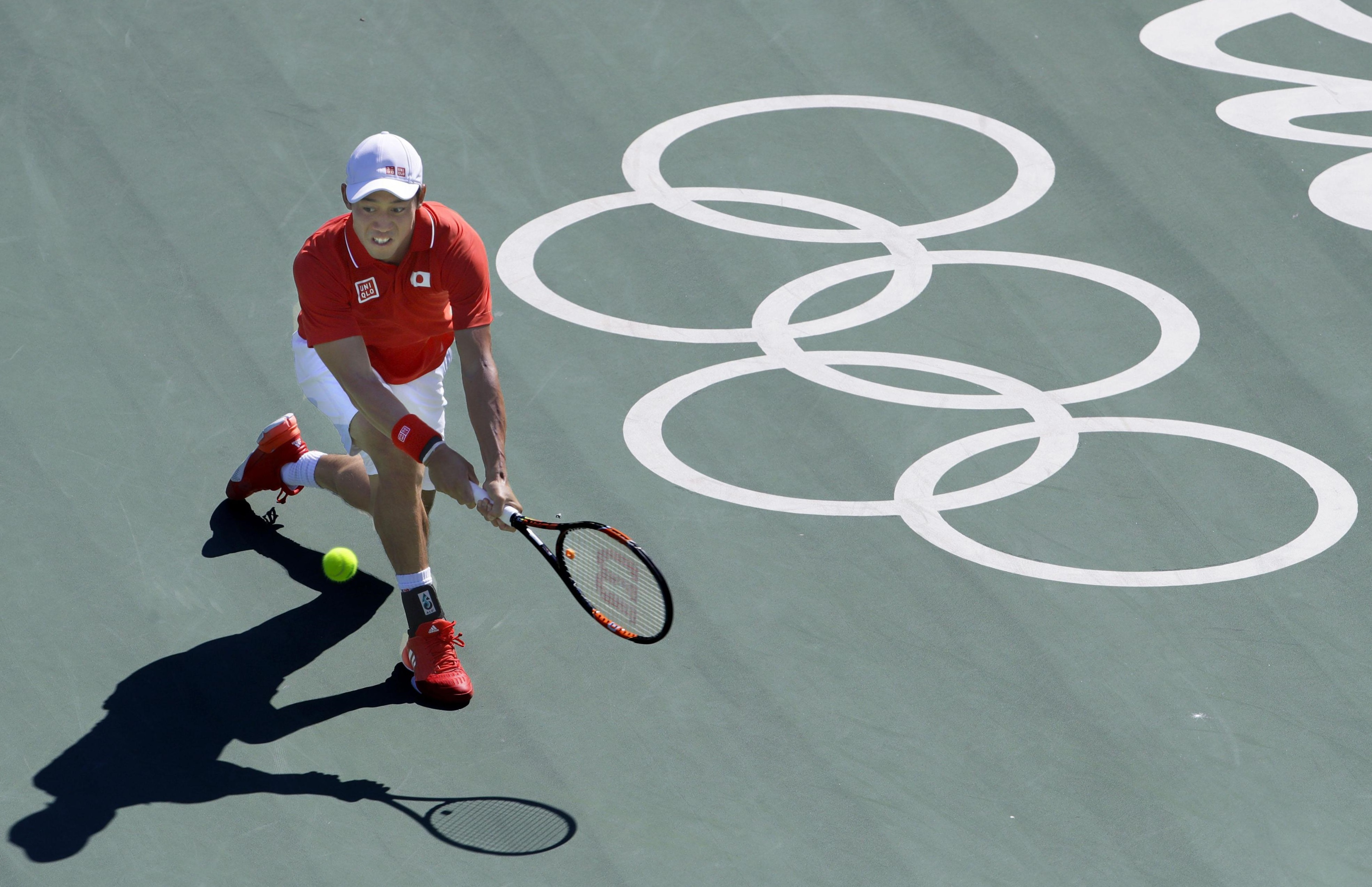 Kei Nishikori returns the ball to Spain's Rafael Nadal on Sunday during their match for the bronze medal in men's singles tennis at the 2016 Rio Olympics. Nishikoro won the match 6-2, 6-7 (1-7), 6-3.   KYODO
