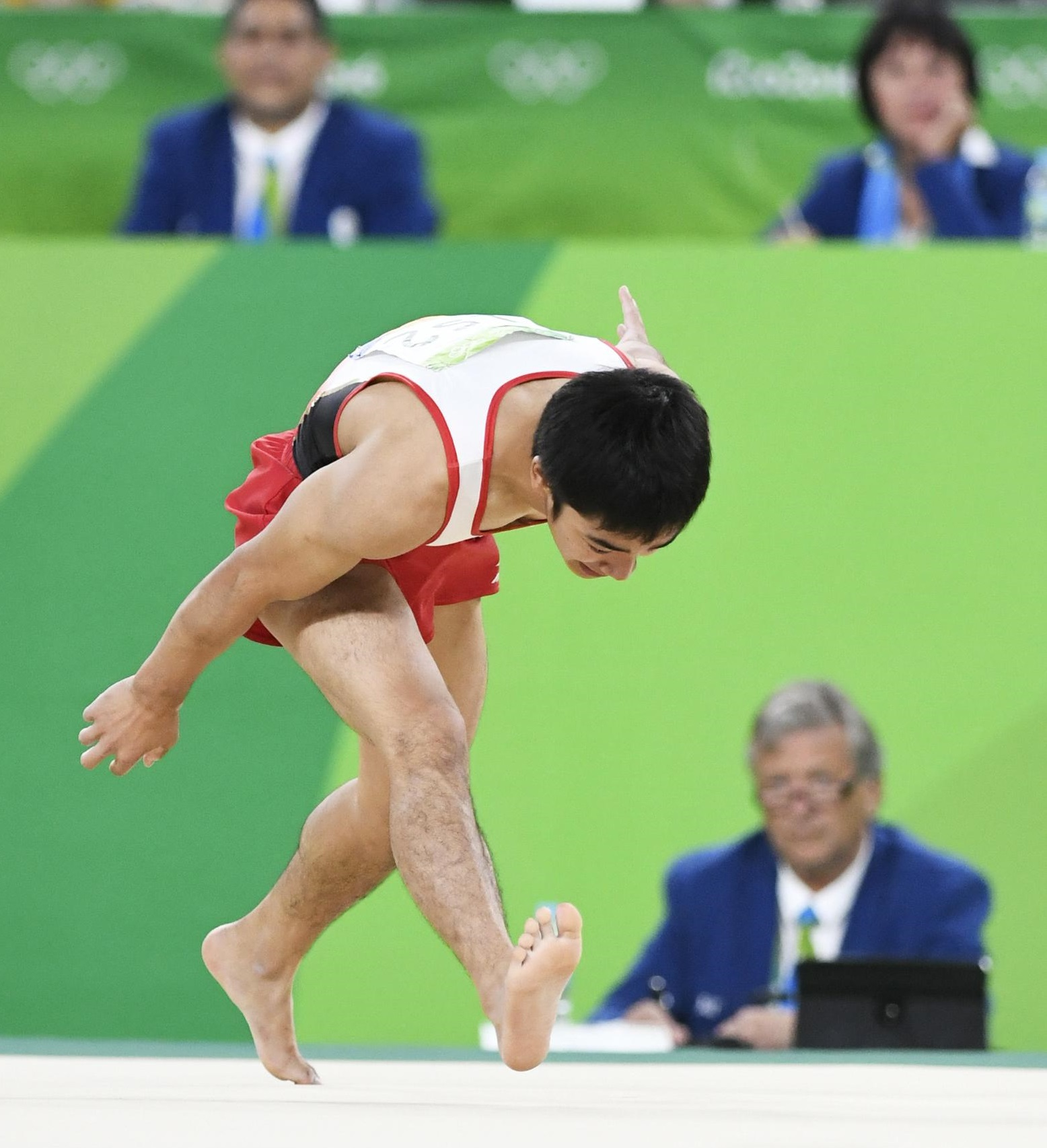 Kenzo Shirai stumbles during his floor routine of the artistic gymnastics men's apparatus final  at the 2016 Summer Olympics in Rio de Janeiro on Sunday. | KYODO