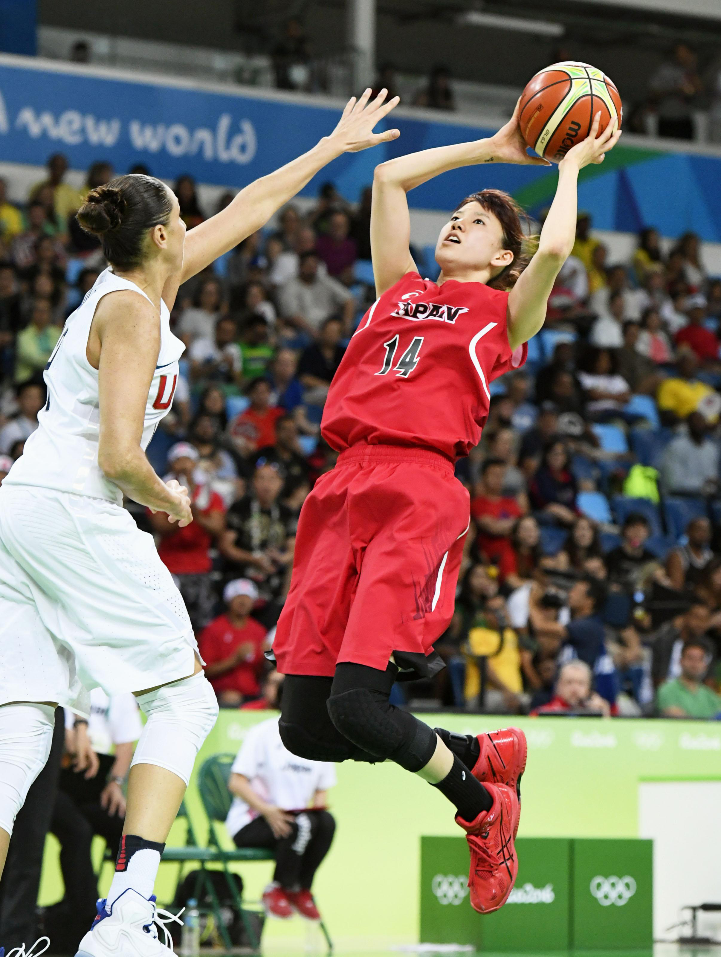 Sanae Motokawa shoots during the women's basketball quarterfinal game against the United States on Tuesday at the 2016 Rio Games. The U.S. won 110-64. |   KYODO
