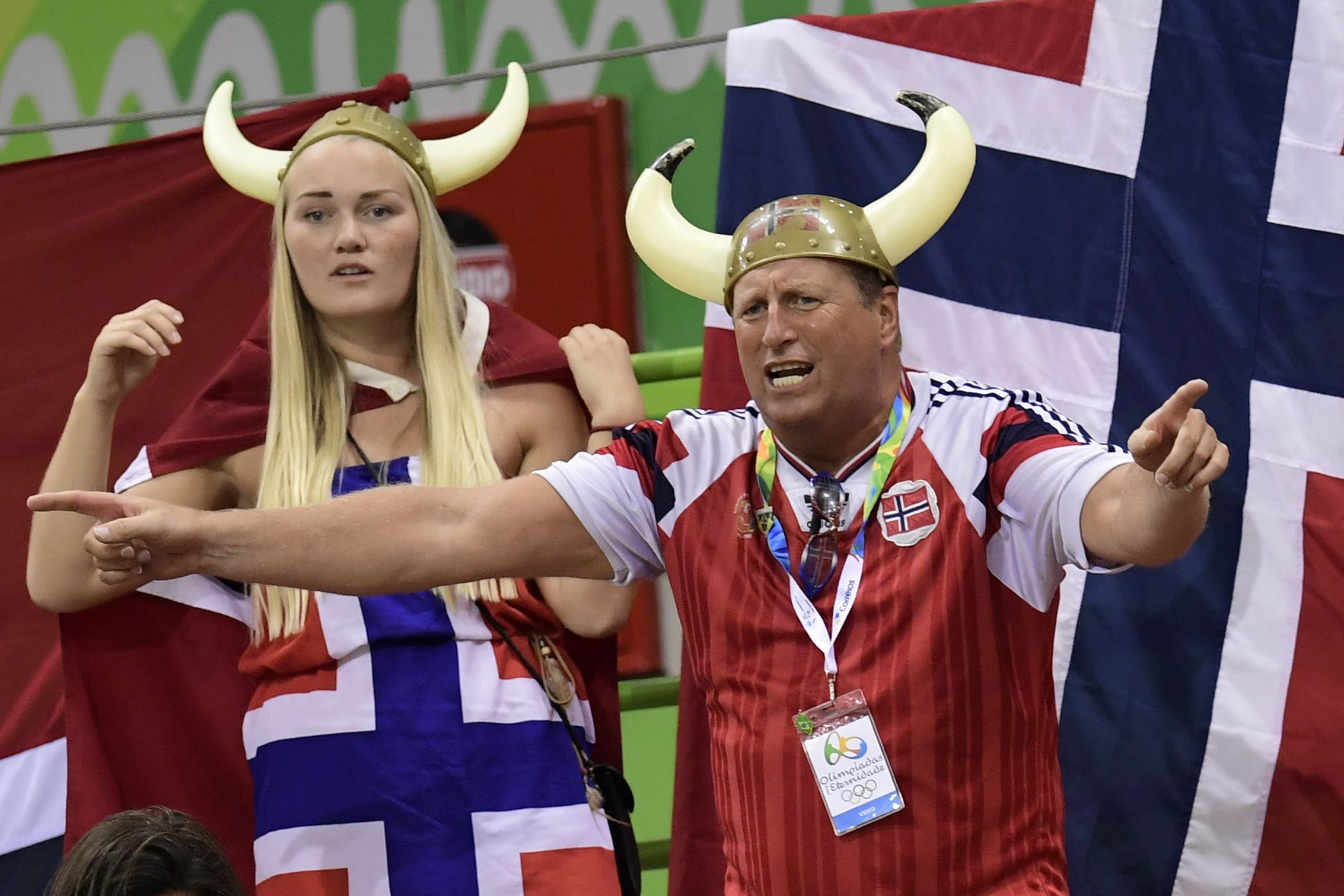 Norwegian fans sporting Viking helmets cheer on their team during the women's quarterfinal handball match against Sweden on Tuesday at the Rio de Janeiro 2016 Olympics Games. |   AFP-JIJI