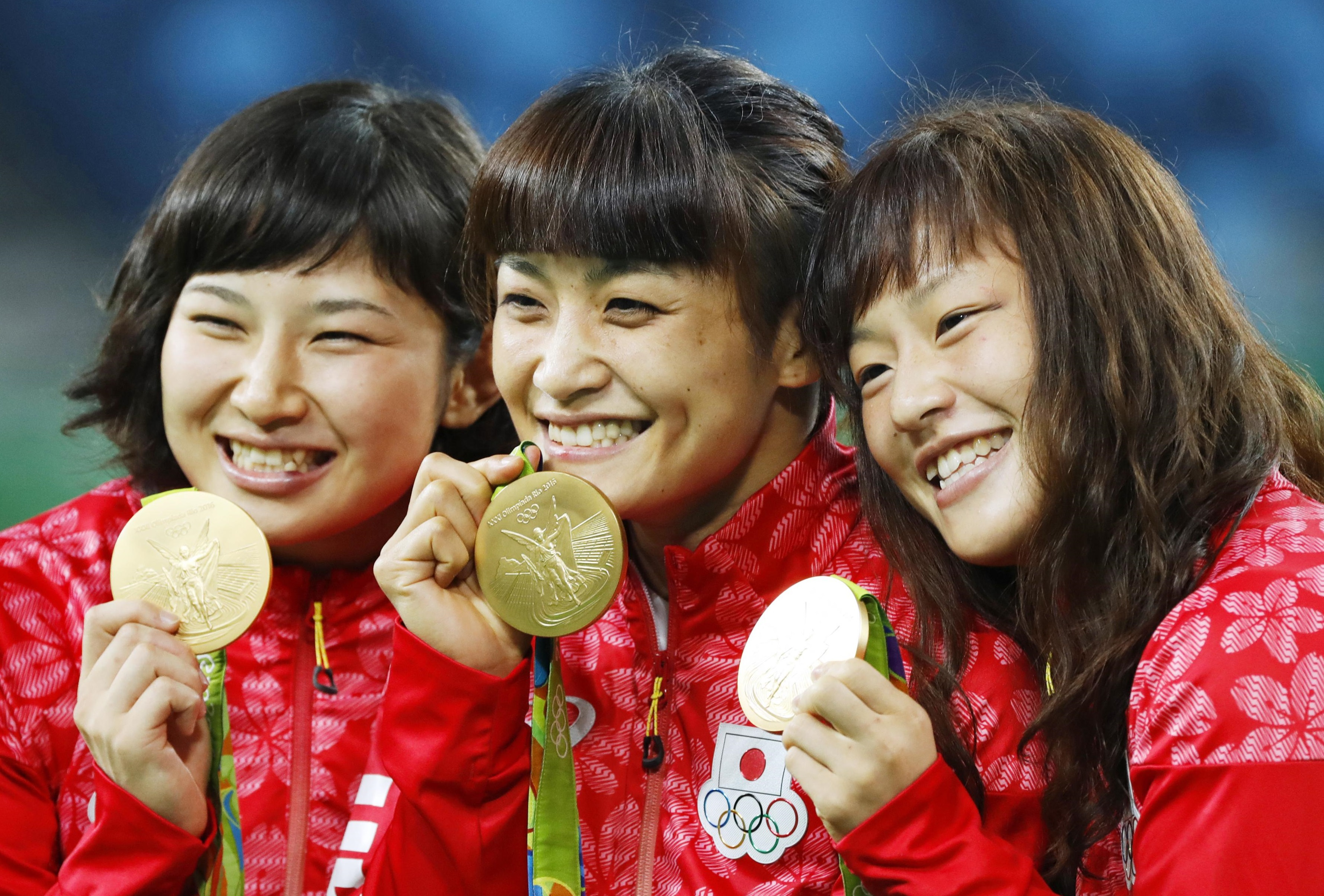 Gold medalists Sara Dosho (left), Kaori Icho (center) and Eri Tosaka pose after winning the women's wrestling finals on Wednesday at the 2016 Summer Olympic Games in Rio de Janeiro. | KYODO