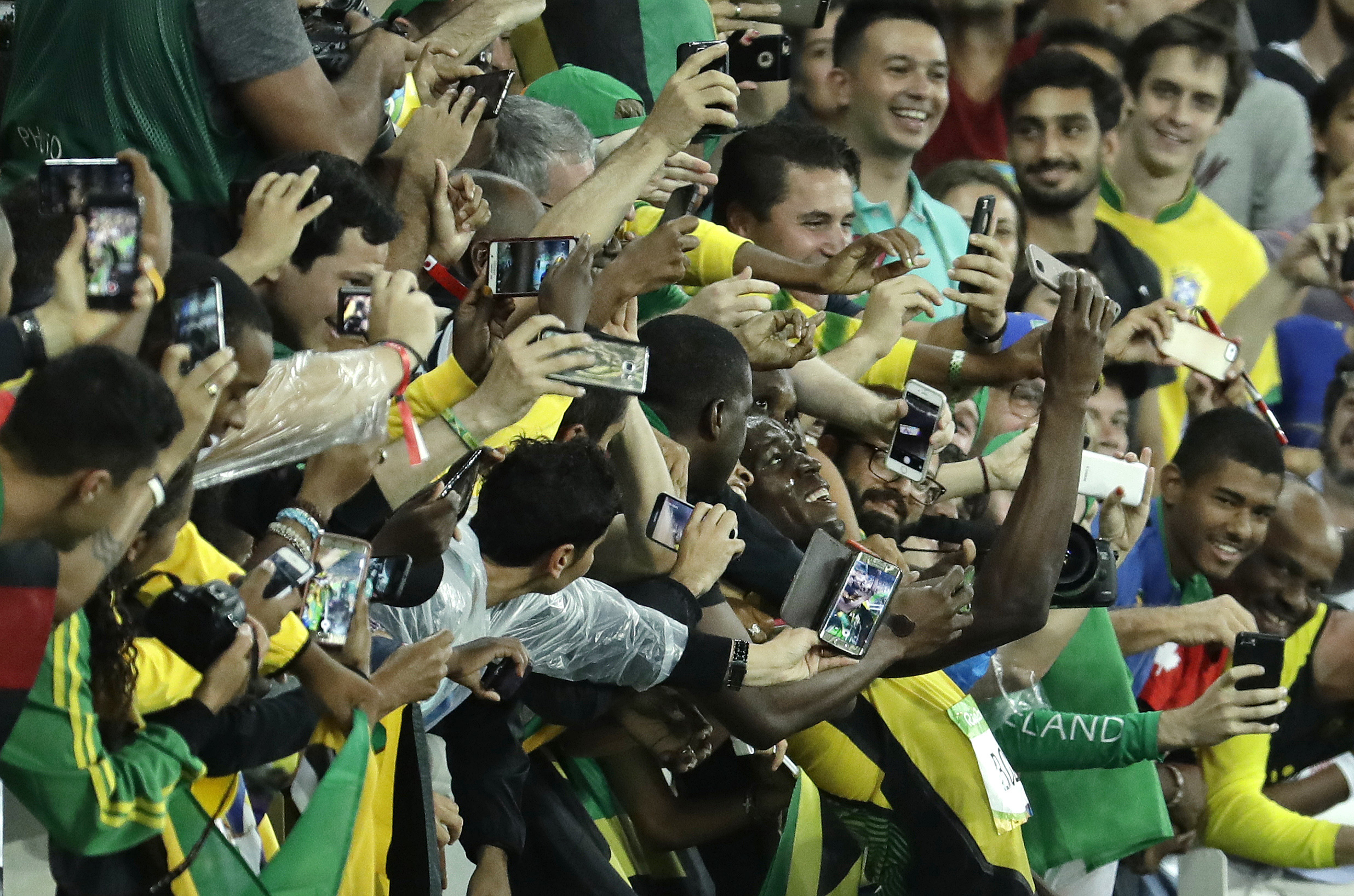 Jamaica's Usain Bolt celebrates with spectators after winning the gold medal in the men's 200-meter final at the 2016 Summer Olympics on Thursday. | AP