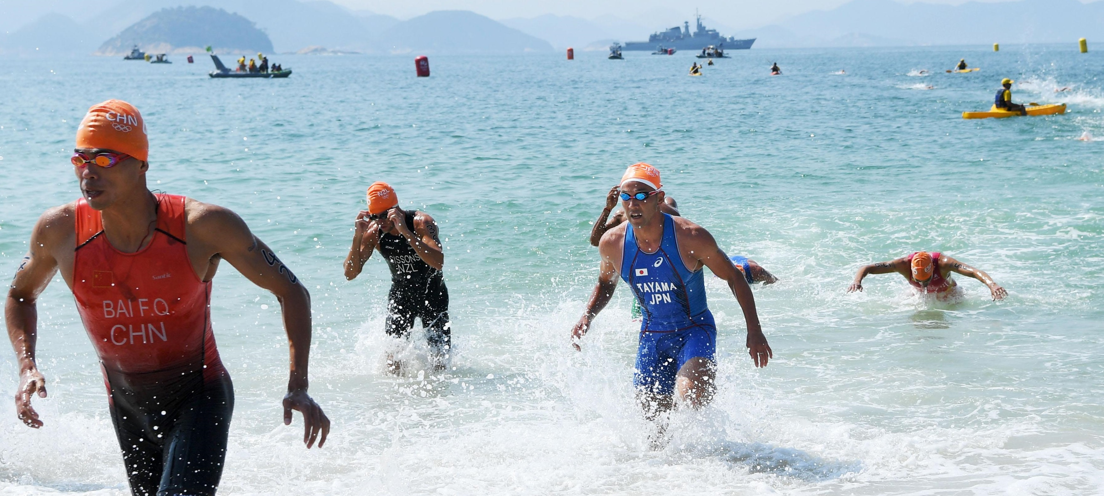 Hirokatsu Tayama of Japan completes the swimming portion of the men's triathlon at the Rio de Janeiro Olympics on Thursday. He later withdrew from the competition. | KYODO